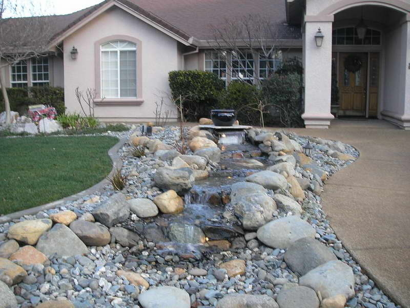 Modern Stone Yard With Pond (Image 7 of 11)
