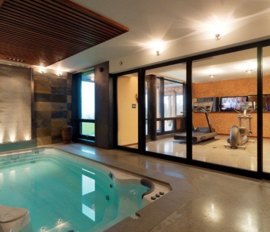 Beautiful Gym Room Beside Swimming Pool (Image 2 of 10)