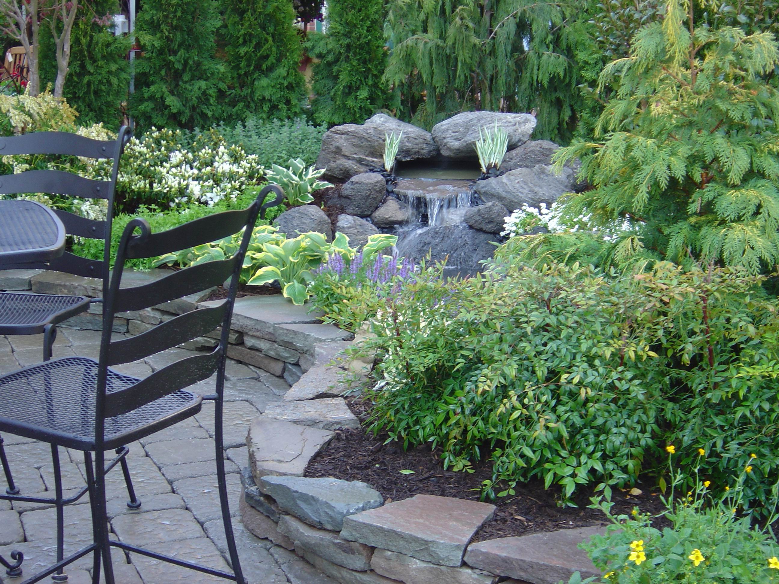 Beautiful Landscaping With Garden Deck View (Photo 1 of 10)