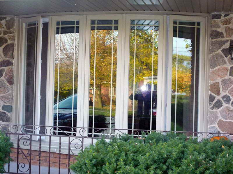High Quality Material Of The Larson Storm Windows With Iron Fence (Image 4 of 10)