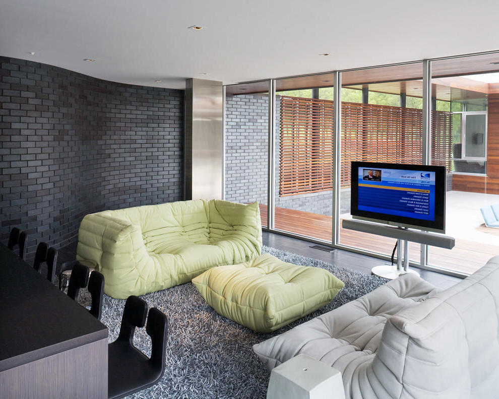 Contemporary Living Room With Togo Sofa And Carpet Flooring (Image 5 of 17)