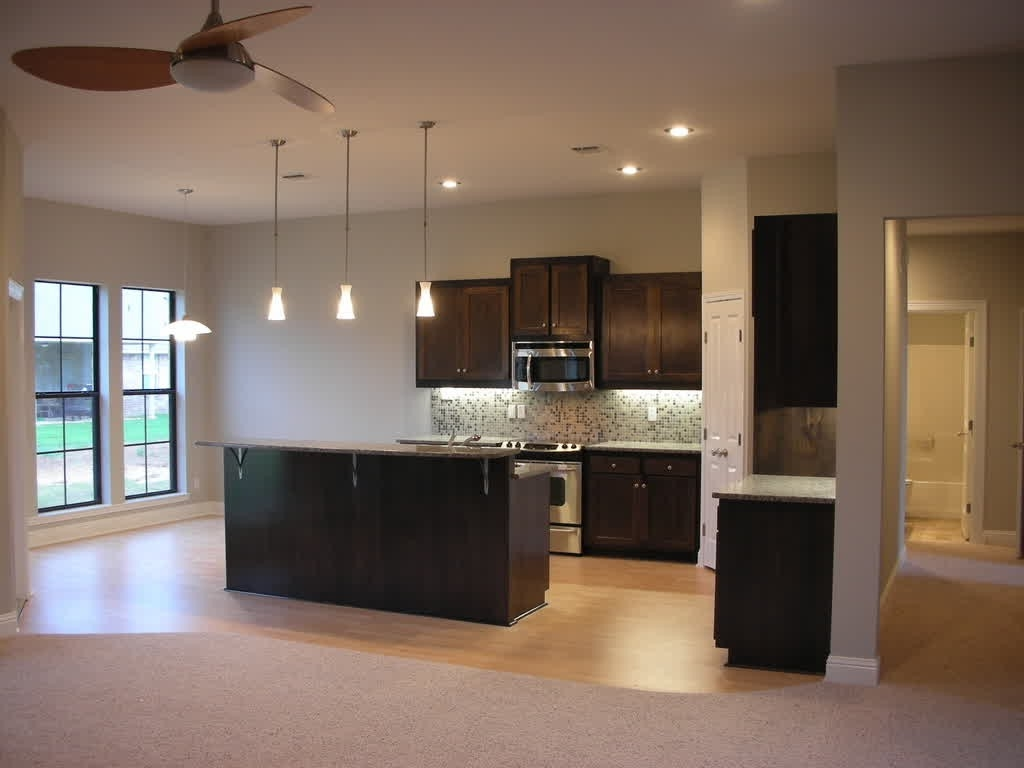Mesmerizing Home Decorators Ideas For Open Kitchen With Dark Oak Island And Grey Granite Top Under