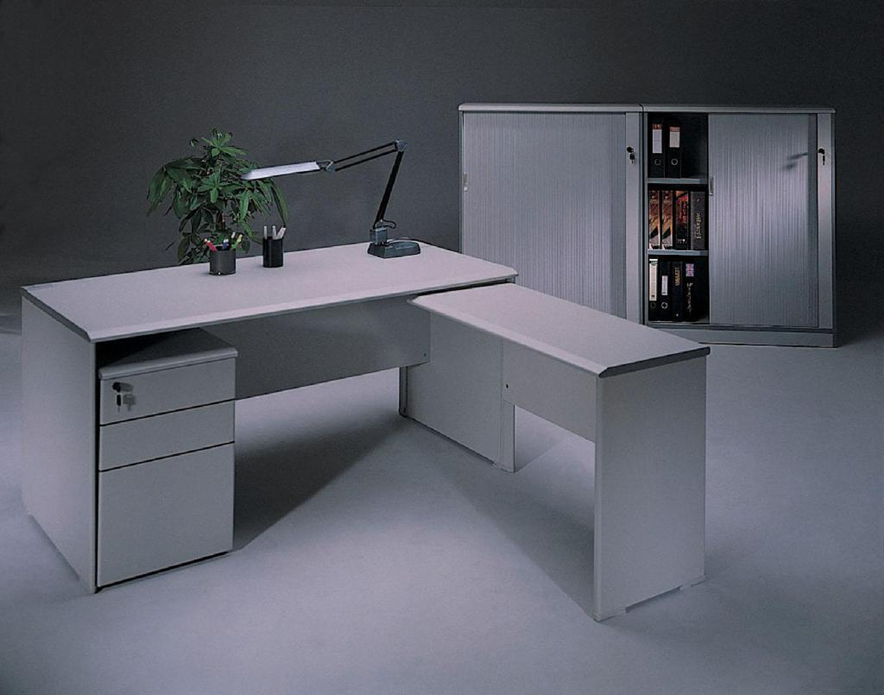 Admirable Modern Home Office Desk Design Idea In White With Black Silver Desk Lamp Green Plant And White Cabinet With Open Shelves Fabulous Modern Home Office Desk Design Ideas (View 19 of 30)