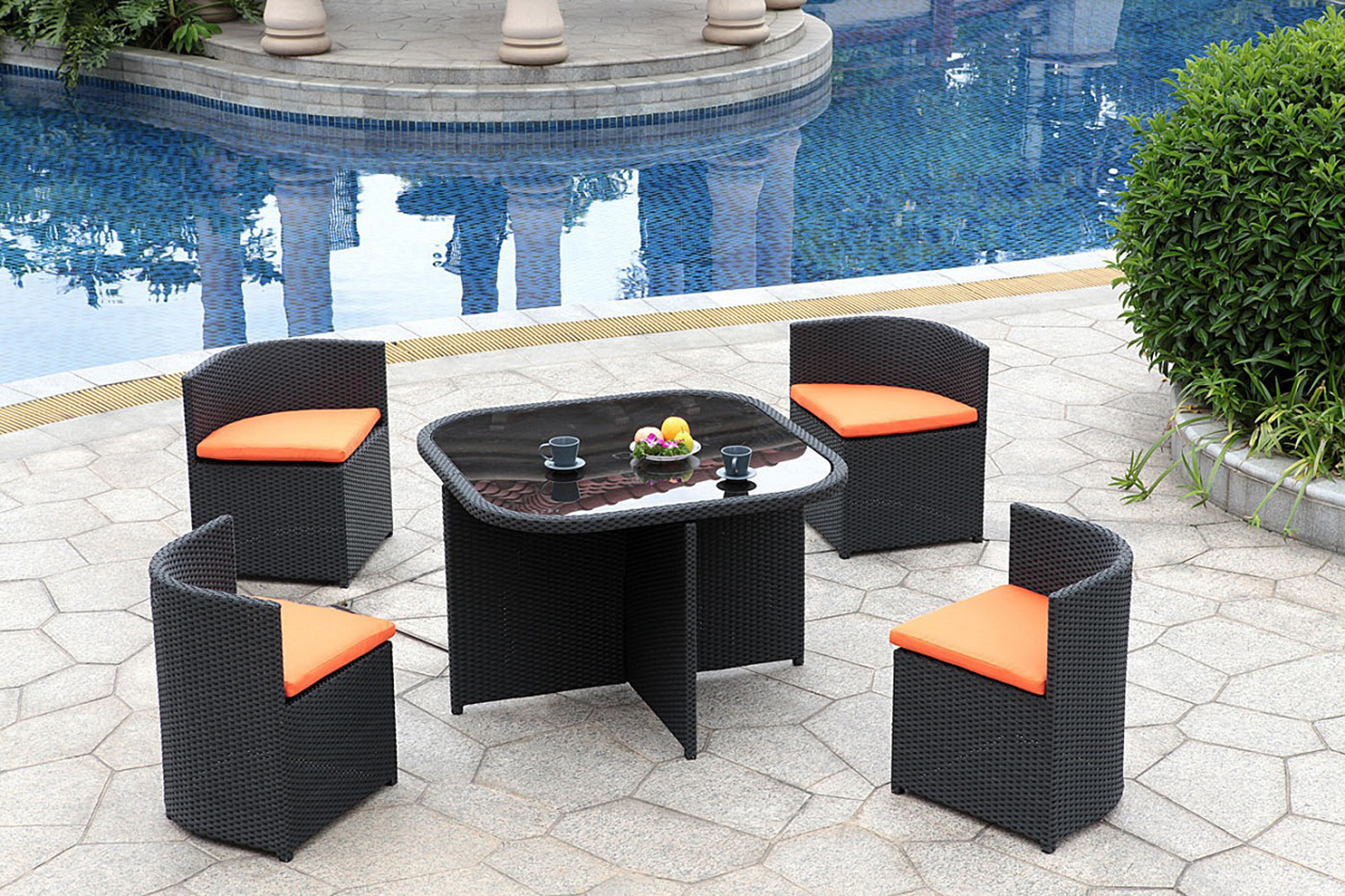 Amazing Modern Outdoor Furniture Design Idea With Glass Top Dining Table With Black Base And Black Chairs With Orange Seat Cushions Affordable Modern Outdoor Furniture Design Ideas (View 21 of 28)