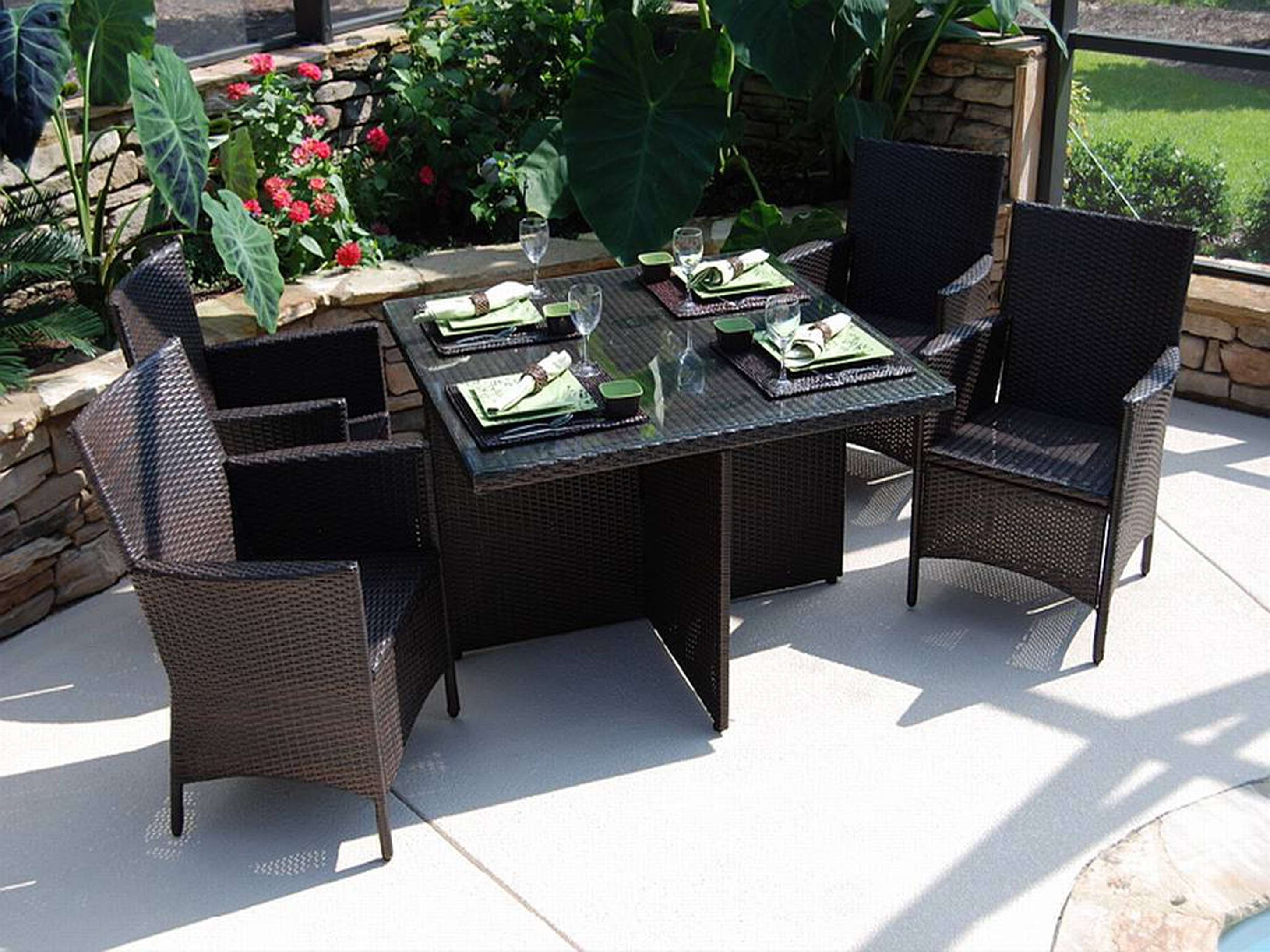 Amazing Outdoor Dining Set Idea With Black Table With Glasses Red Flowers And Black Chairs Admirable Outdoor Dining Set Ideas (View 24 of 28)