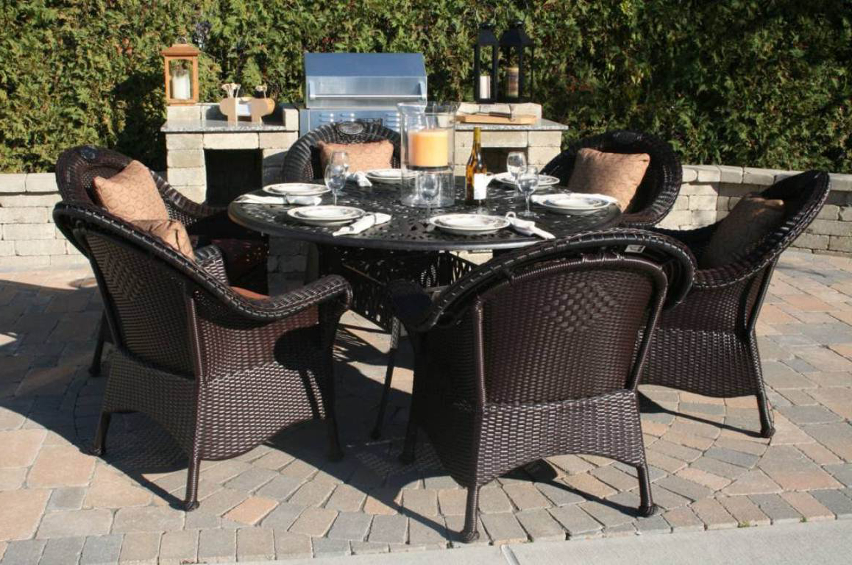 Amazing Outdoor Dining Set Idea With Round Black Table With Cream Candle White Plates And Black Chairs With Light Brown Cushions Admirable Outdoor Dining Set Ideas (View 25 of 28)