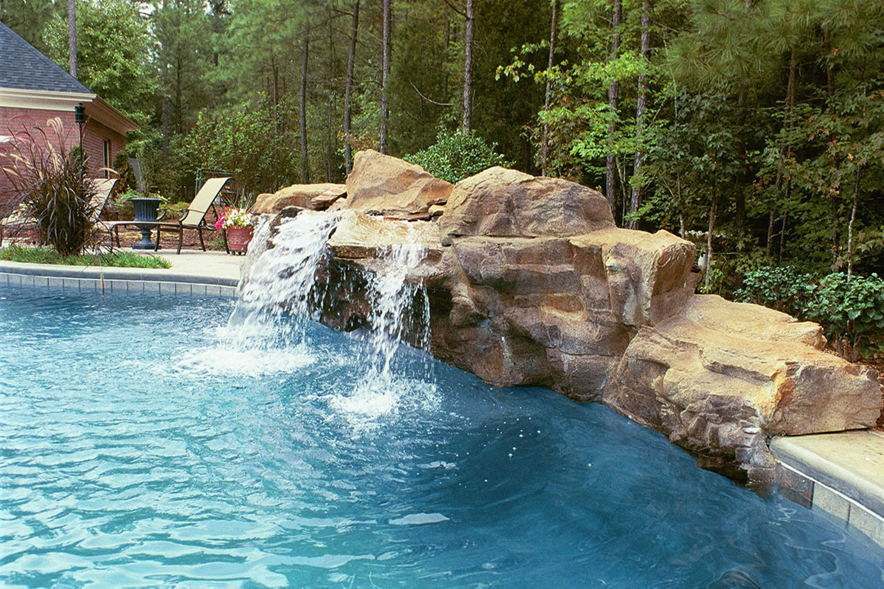 Amazing Pool Design Inspiration With Blue Pool Water And Brown Stones With Waterfall Beautiful Pool Design Inspiration (View 3 of 28)