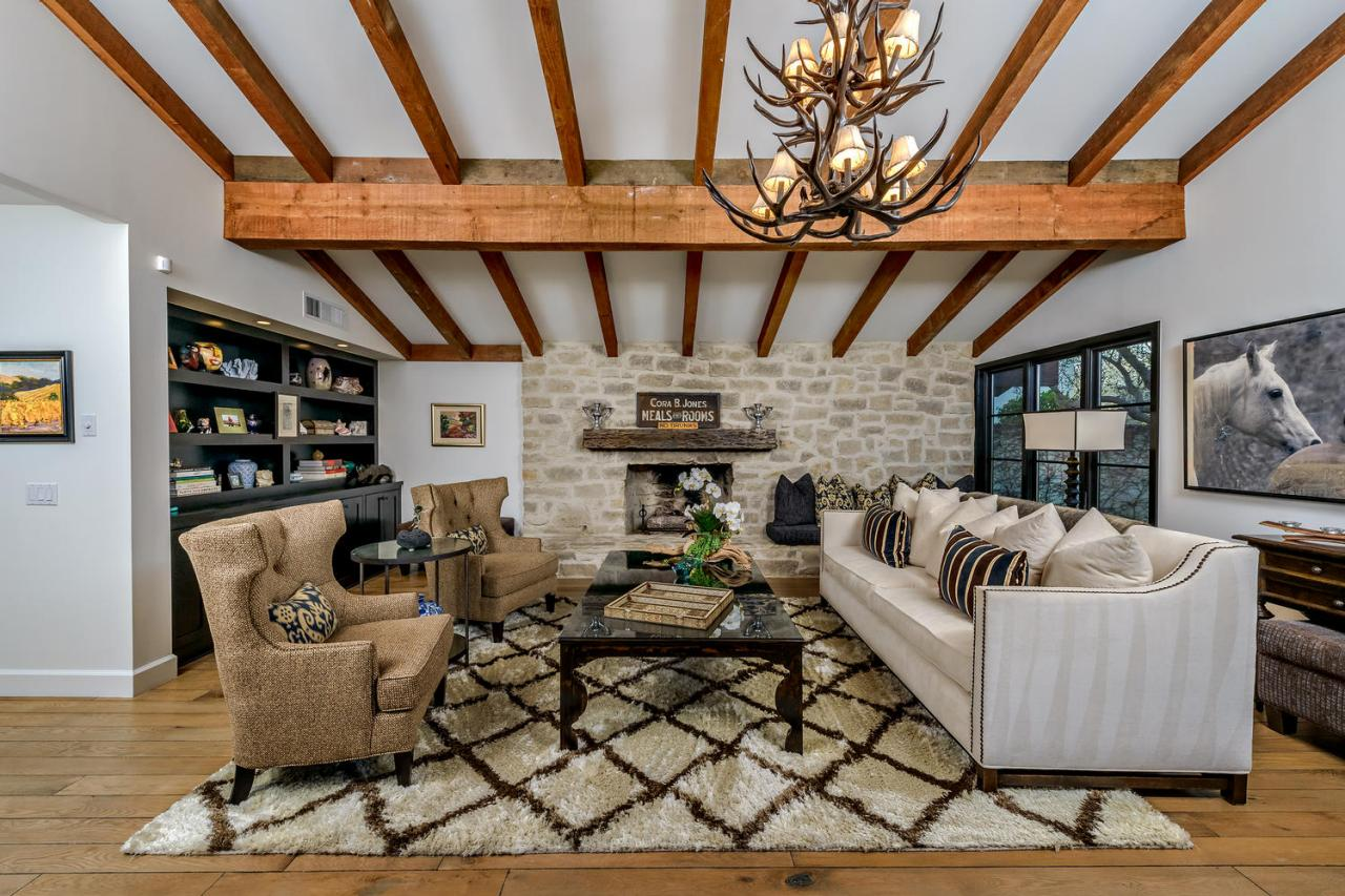 Beautiful Deluxe Rustic Living Room With Elegance Sofa And Stone Fireplace (Image 1 of 10)