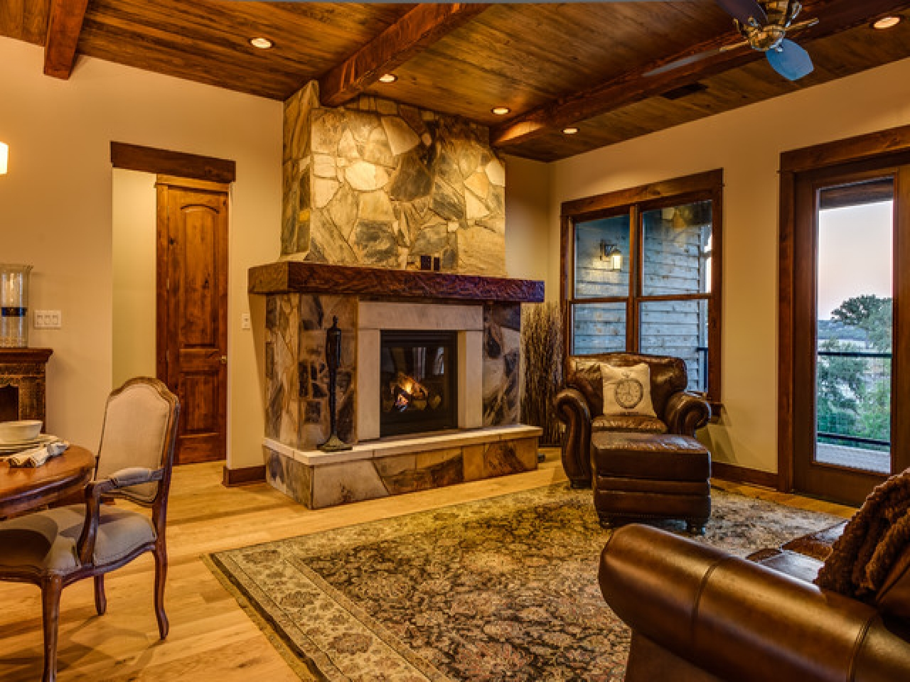 Classic And Rustic Living Room With Stone Fireplace And Carpet Flooring (Image 3 of 10)
