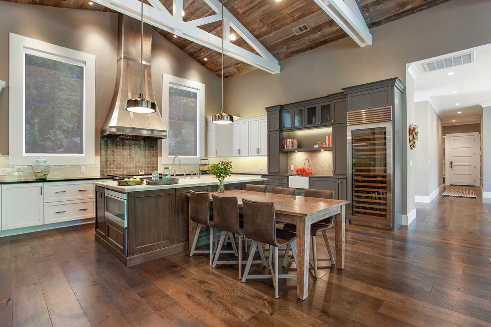 Example Of A Mid Sized Country Rustic U Shaped Open Concept Kitchen With A Farmhouse Sink Recessed Panel Cabinets (Image 3 of 19)