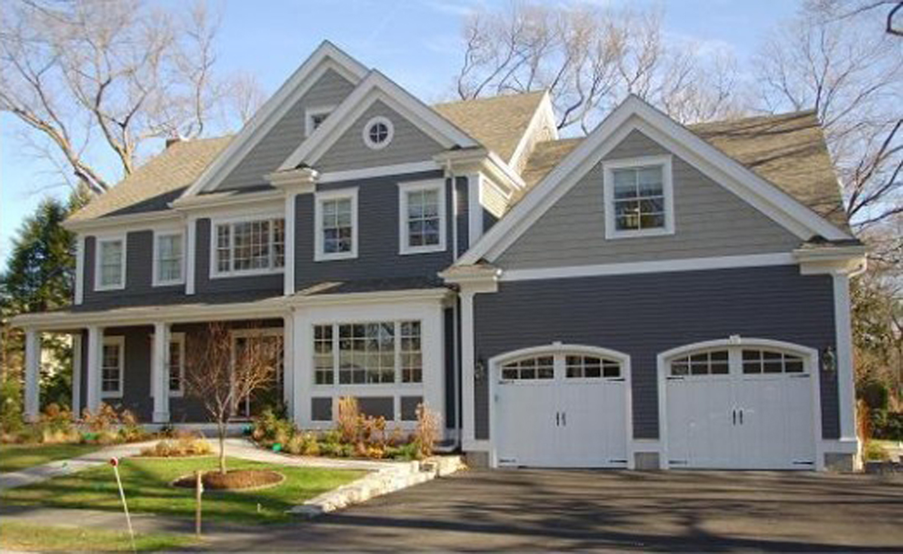 Luxurious Gray House Exterior Paint Idea With White Garage Doors And White Window Frames Beautiful House Exterior Paint Ideas (Image 8 of 123)