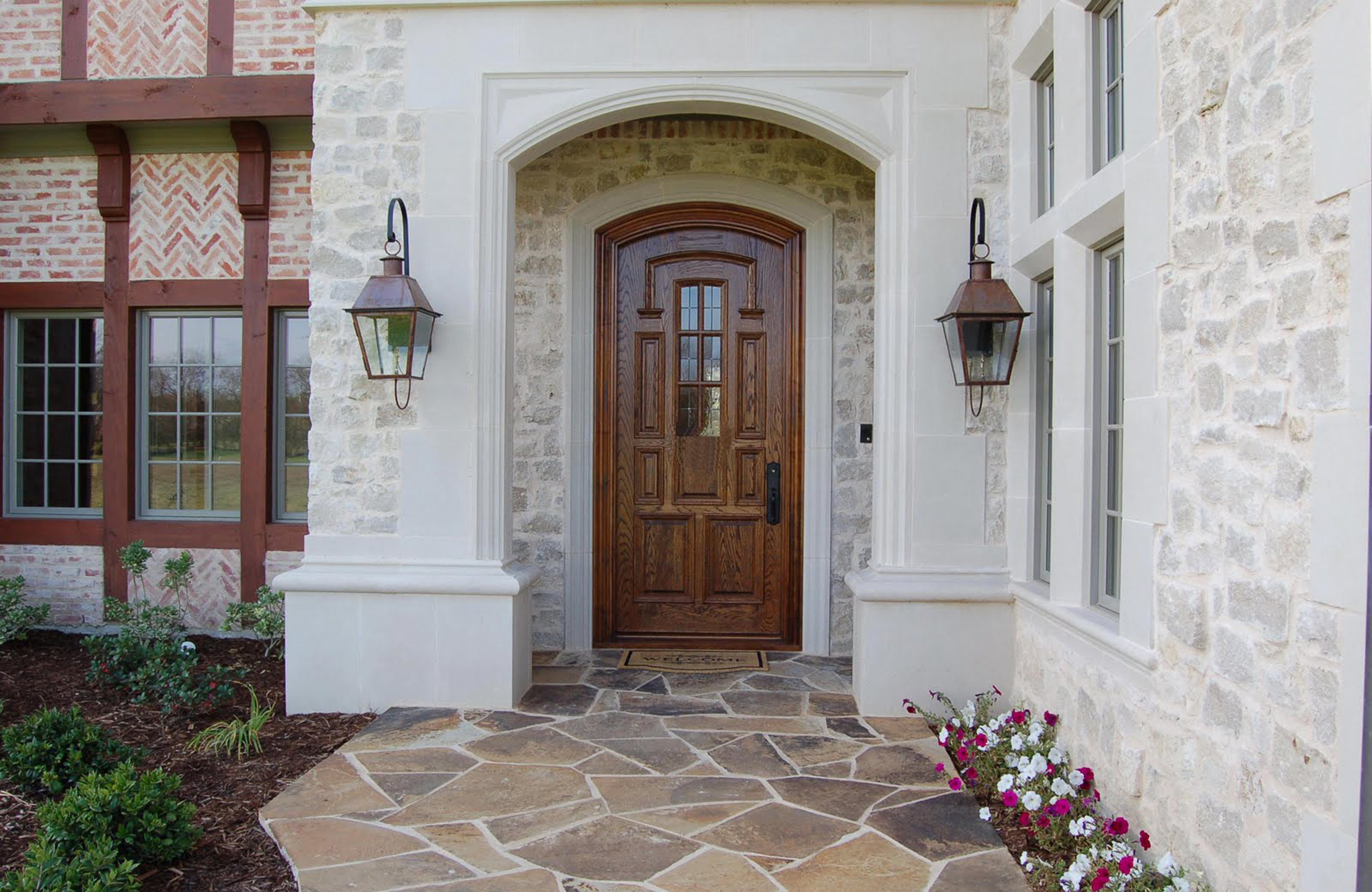 Luxury Brown Wooden Front Entry Door With Glass Accents And Black Handle And Cream Stone Wall With Brown Wall Lamps And Also Brown Stone Floor Tile Formidable Front Entry Door Designs (Image 51 of 123)