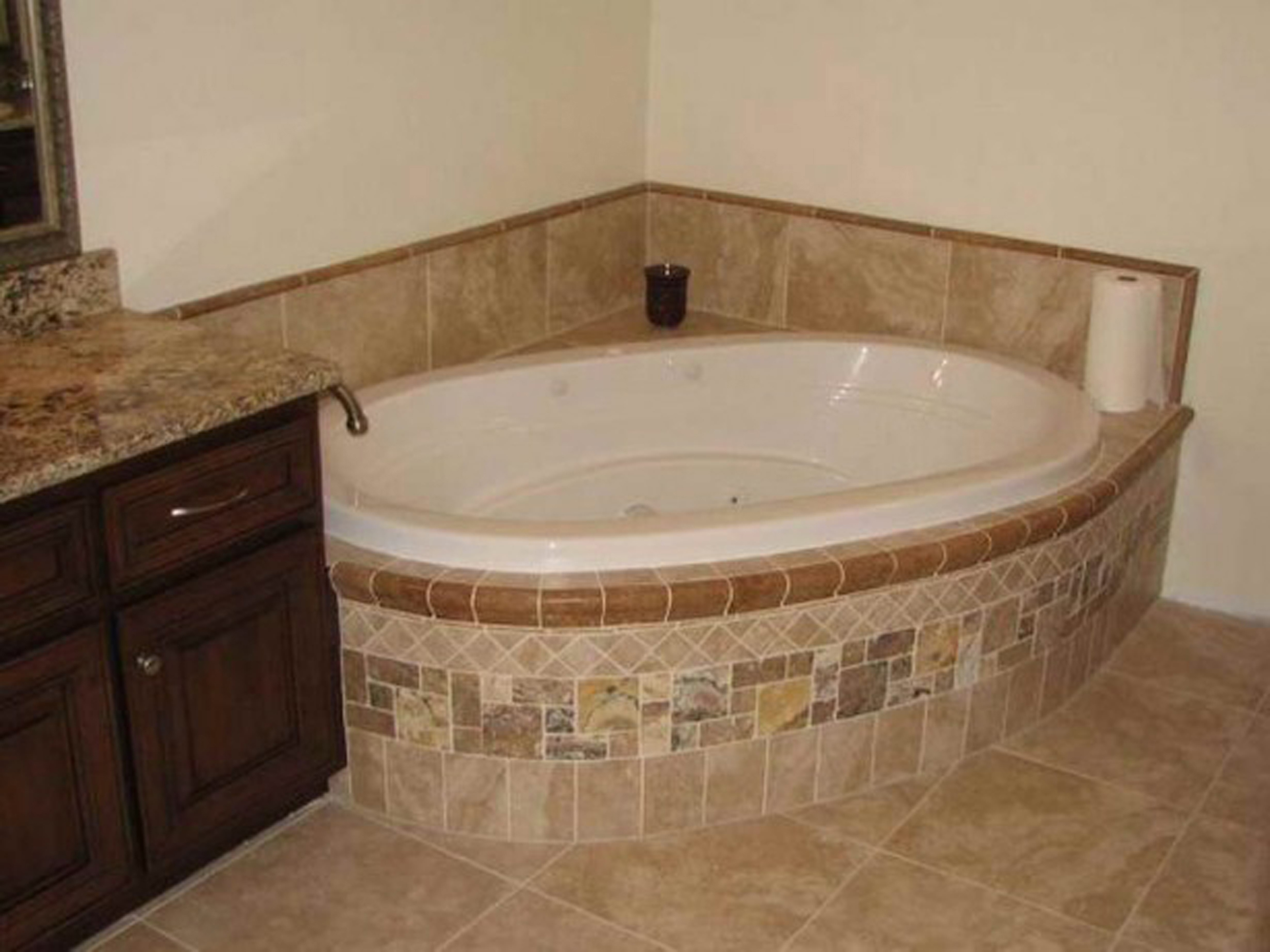Simple Bathroom Nice Oval White Corner Bathtub Design With Chocolate Vanity With Brown Countertop And Brown Floor Tile And Also White Wall Stunning Ideas For Corner Bathtub Designs (View 4 of 23)