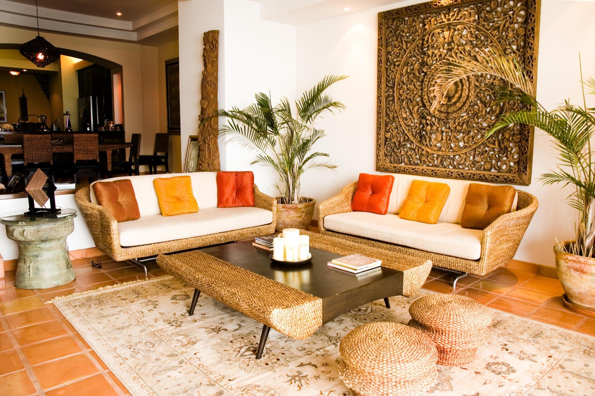 Traditional Indian Living Room With Oriental Wall Decor And Wooden Floor  With Indian Carpet And Rattan