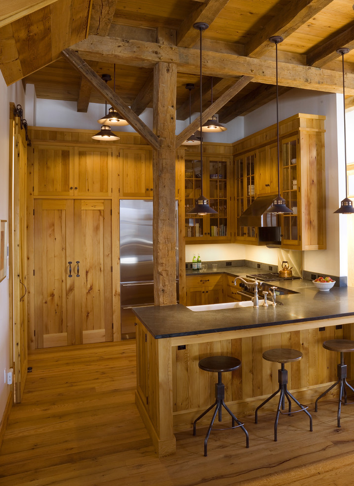 U Shaped Rustic Kitchen Interior With With A Farmhouse Sink Combined With Glass Front Cabinets And Medium Tone Wood Cabinets (Image 11 of 19)
