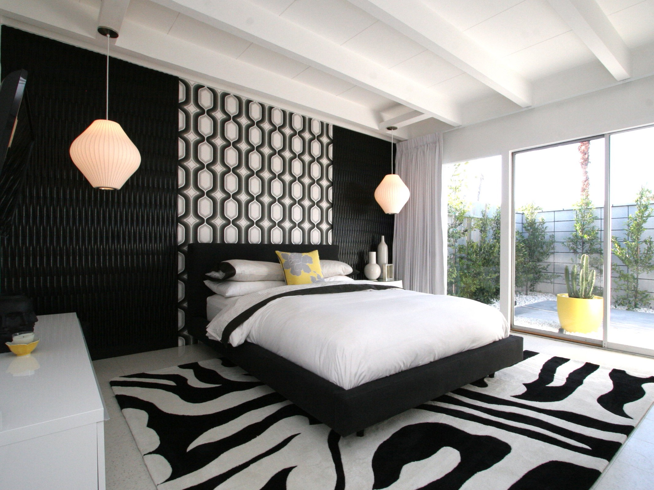 Black And White Modern Bedroom With Large Glass Door (View 4 of 23)