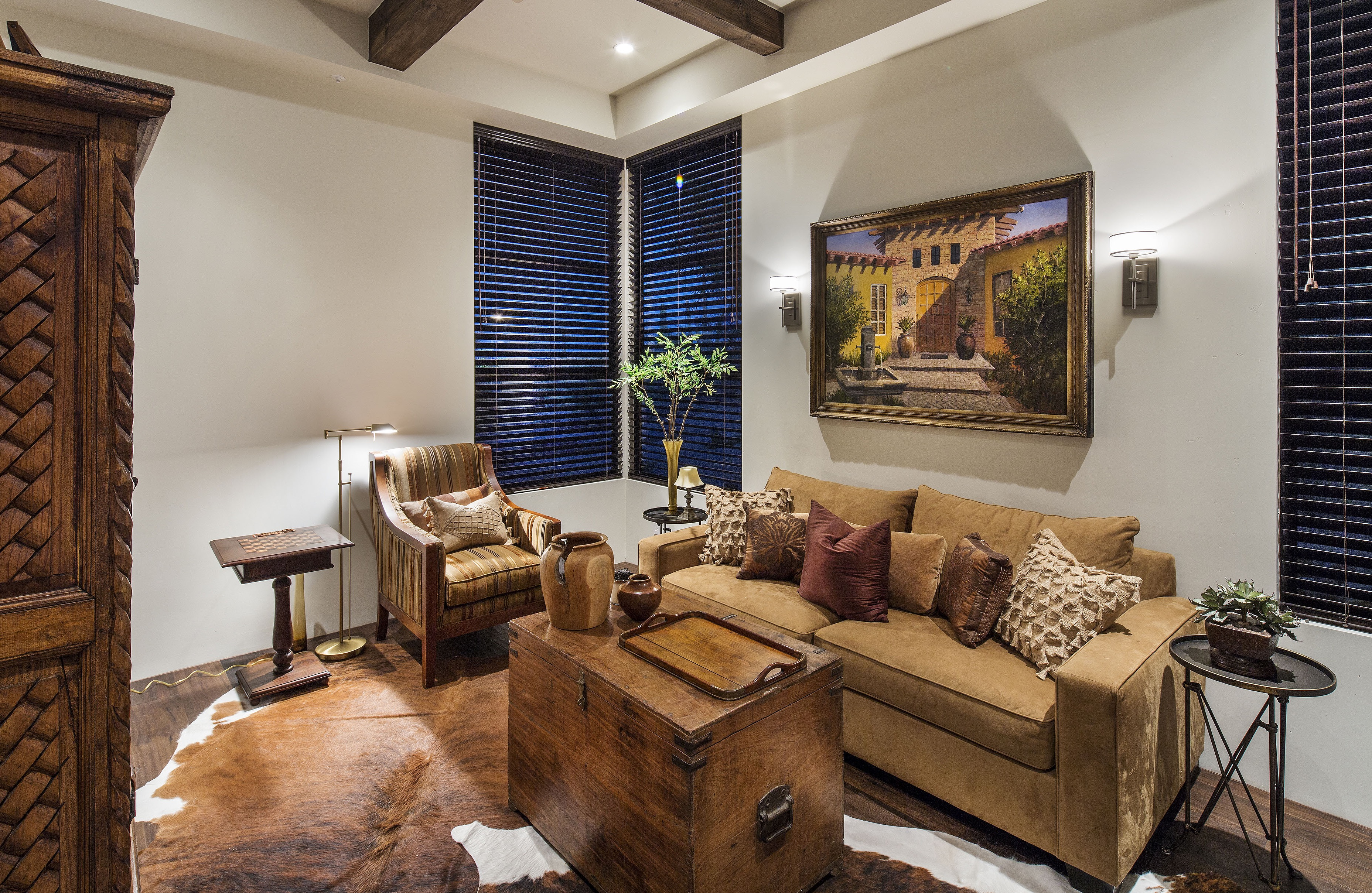 Comfy Southwestern Living Room With Tan Furniture And Cowhide Rug (View 10 of 27)