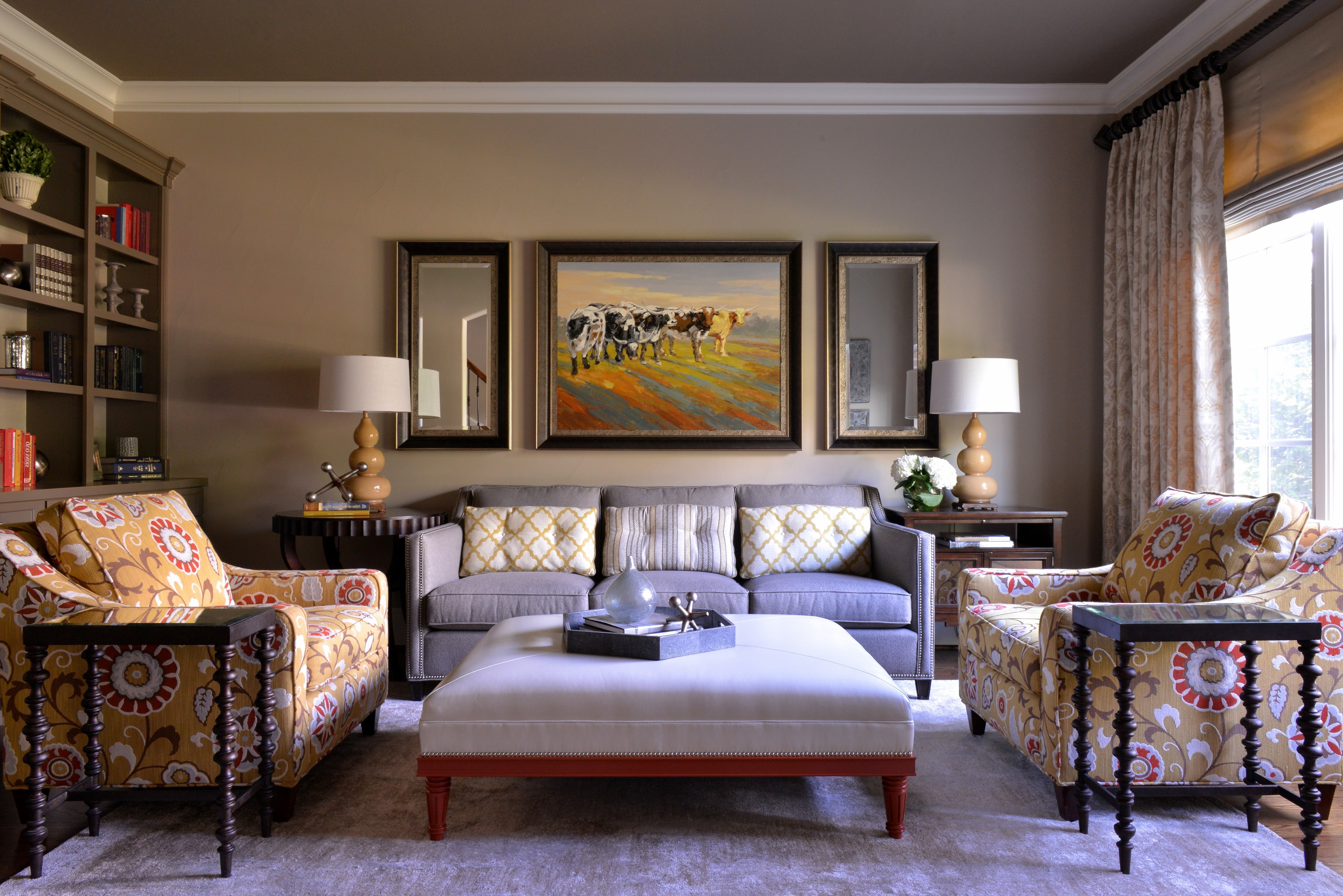 Comfy Transitional Living Room Features Yellow Floral Armchairs And Upholstered Coffee Table (View 11 of 27)