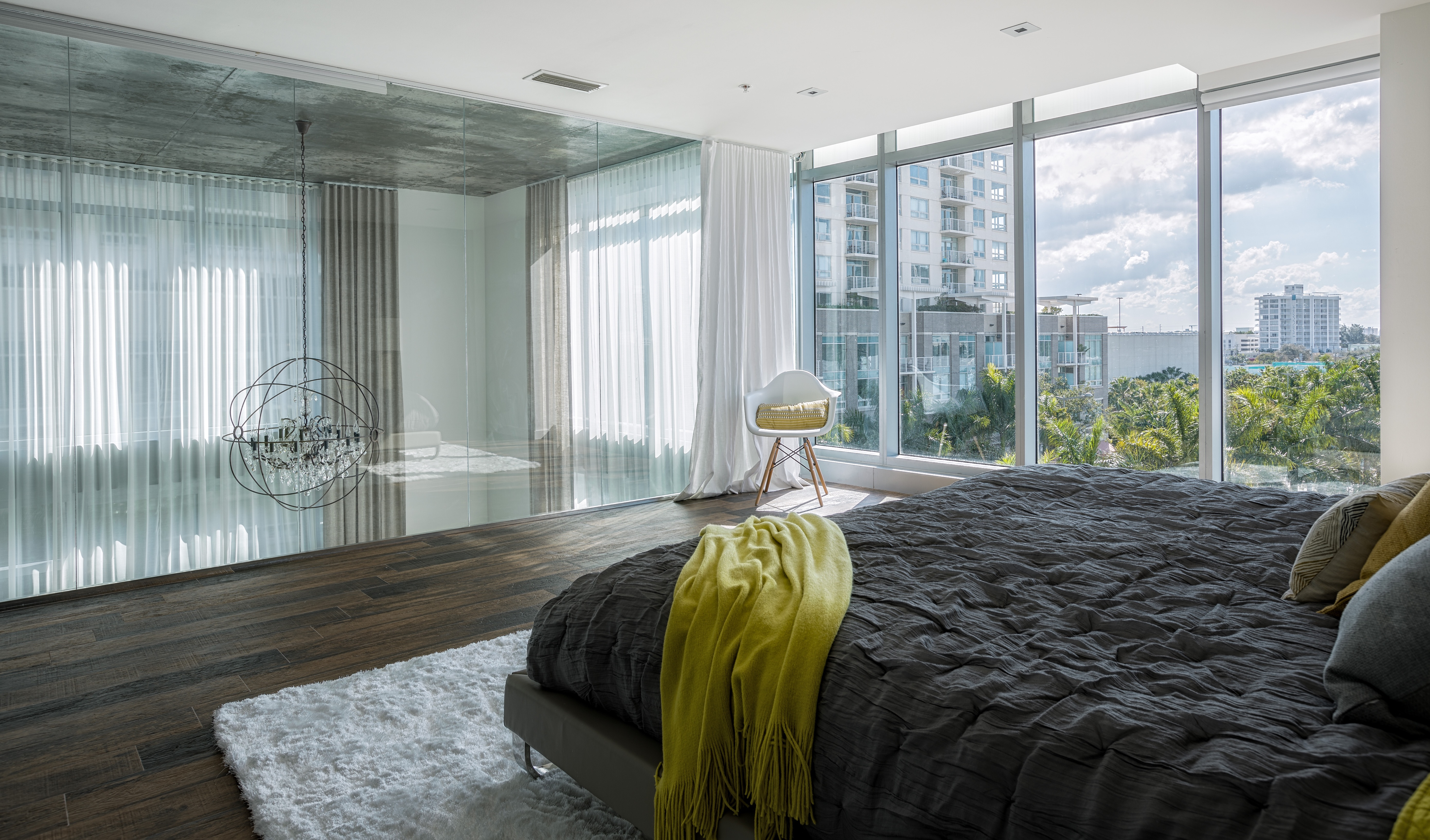 Contemporary Apartment Bedroom With Two Window Walls (View 1 of 28)