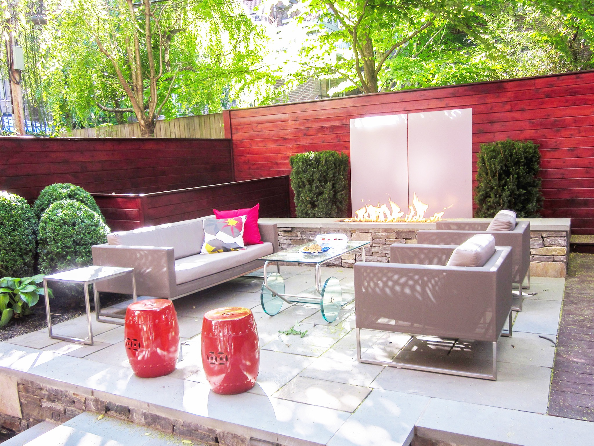 Contemporary Garden Patio With Fire Pit And Glass Coffee Table (Image 12 of 35)