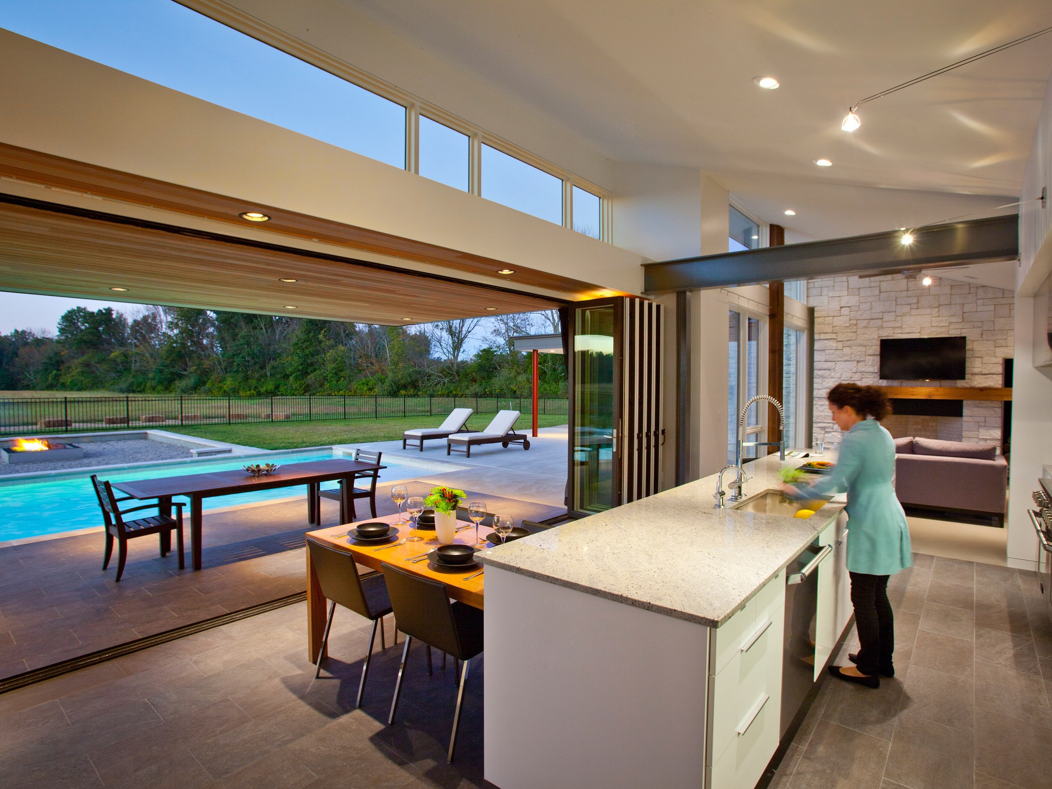 Contemporary Kitchen With Bifolding Glass Doors Open To Swimming Pool And Patio (View 7 of 24)