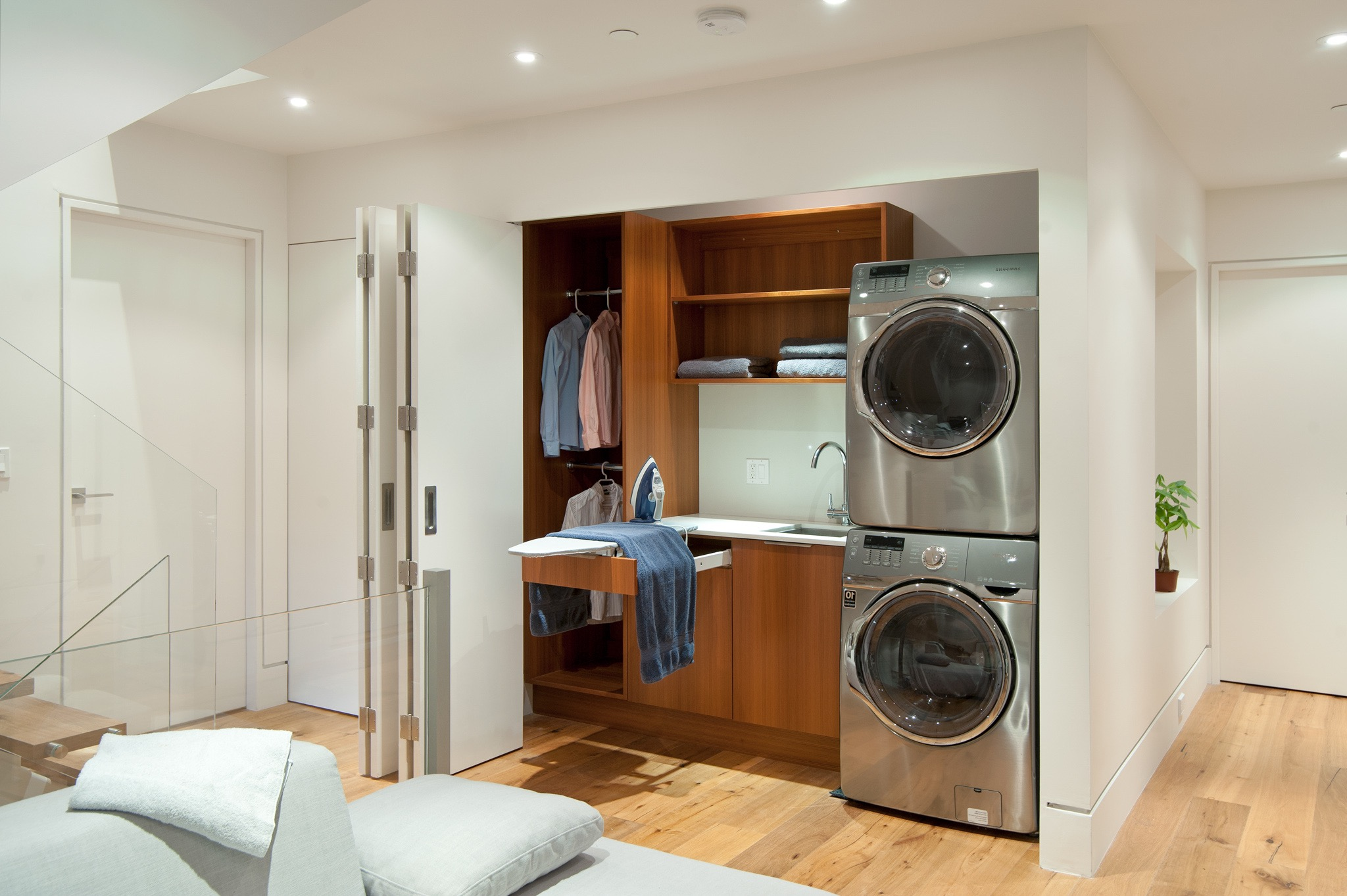 Contemporary Laundry Closet With Teak Cabinetry (Image 6 of 26)