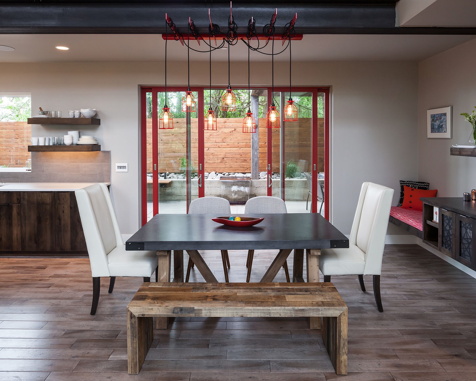 Contemporary Modern Dining Room Features Red Sliding Doors And Creative Light Fixture (View 1 of 13)