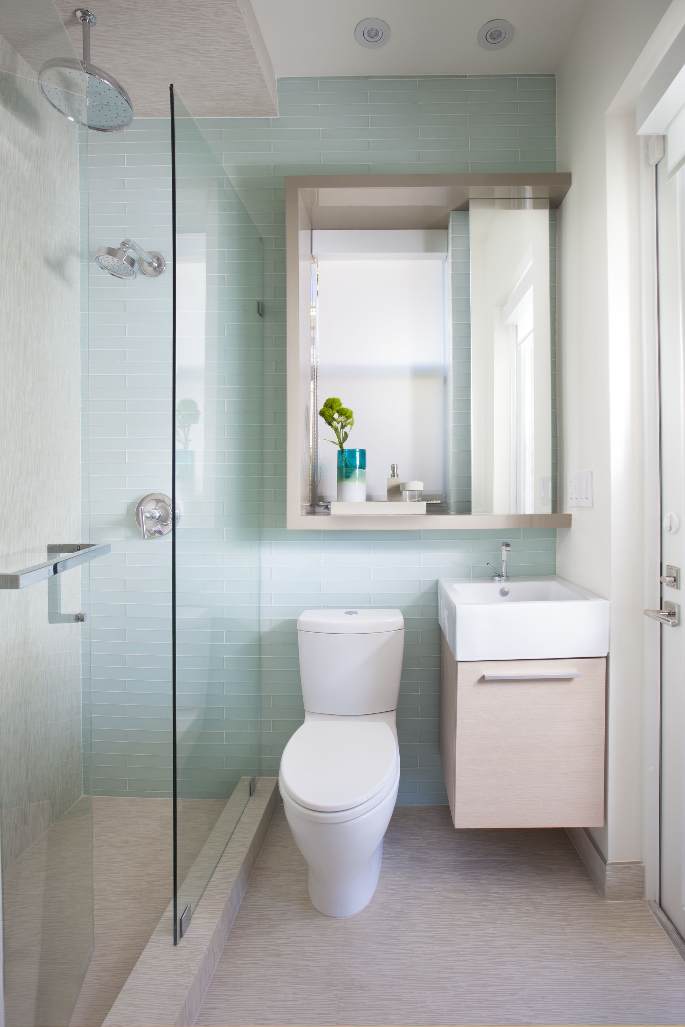 Contemporary Tiny Bathroom Features Light Blue Subway Tile Wall (Image 5 of 14)
