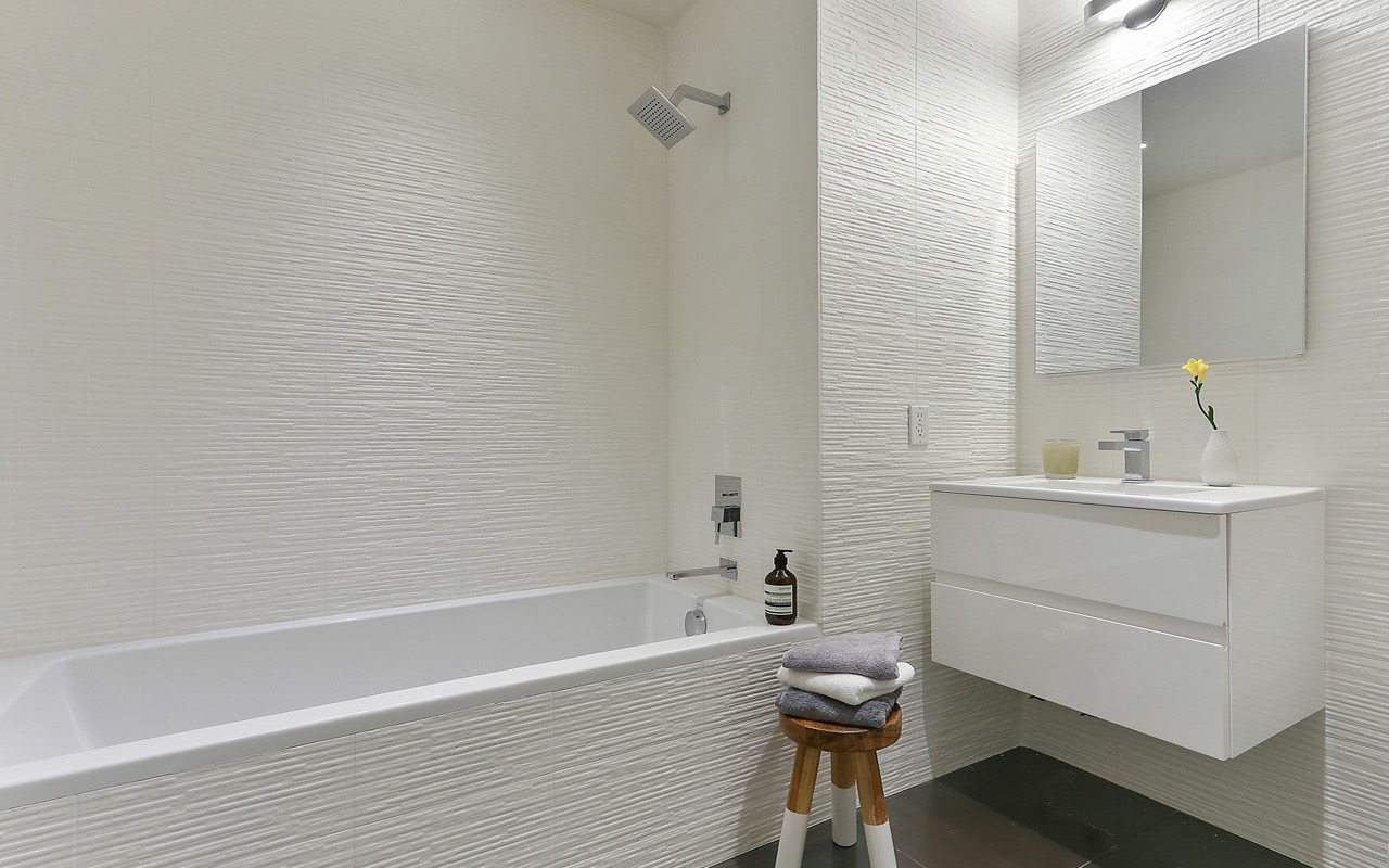 Crisp Contemporary Bathroom With Shower And Tub Combo Boasts Floating Vanity & Textured Tile (Image 8 of 19)