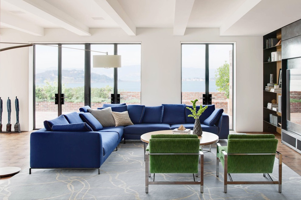 Cushioned Modern Living Room Featuring Blue Sectional Sofa (View 8 of 25)