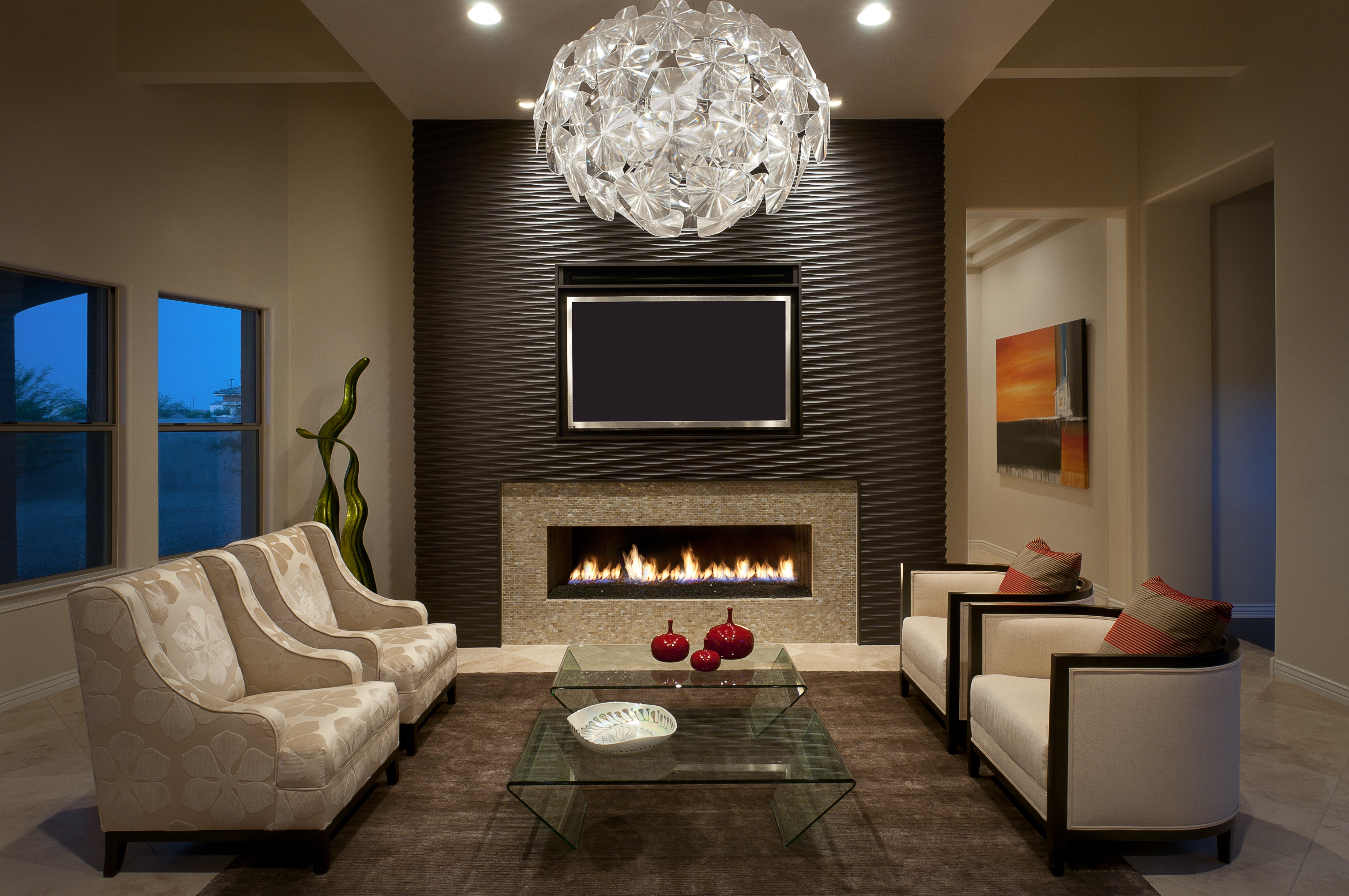 Formal Living Room With Modern Chandelier And Wood Clad Fireplace Surround (Image 8 of 18)