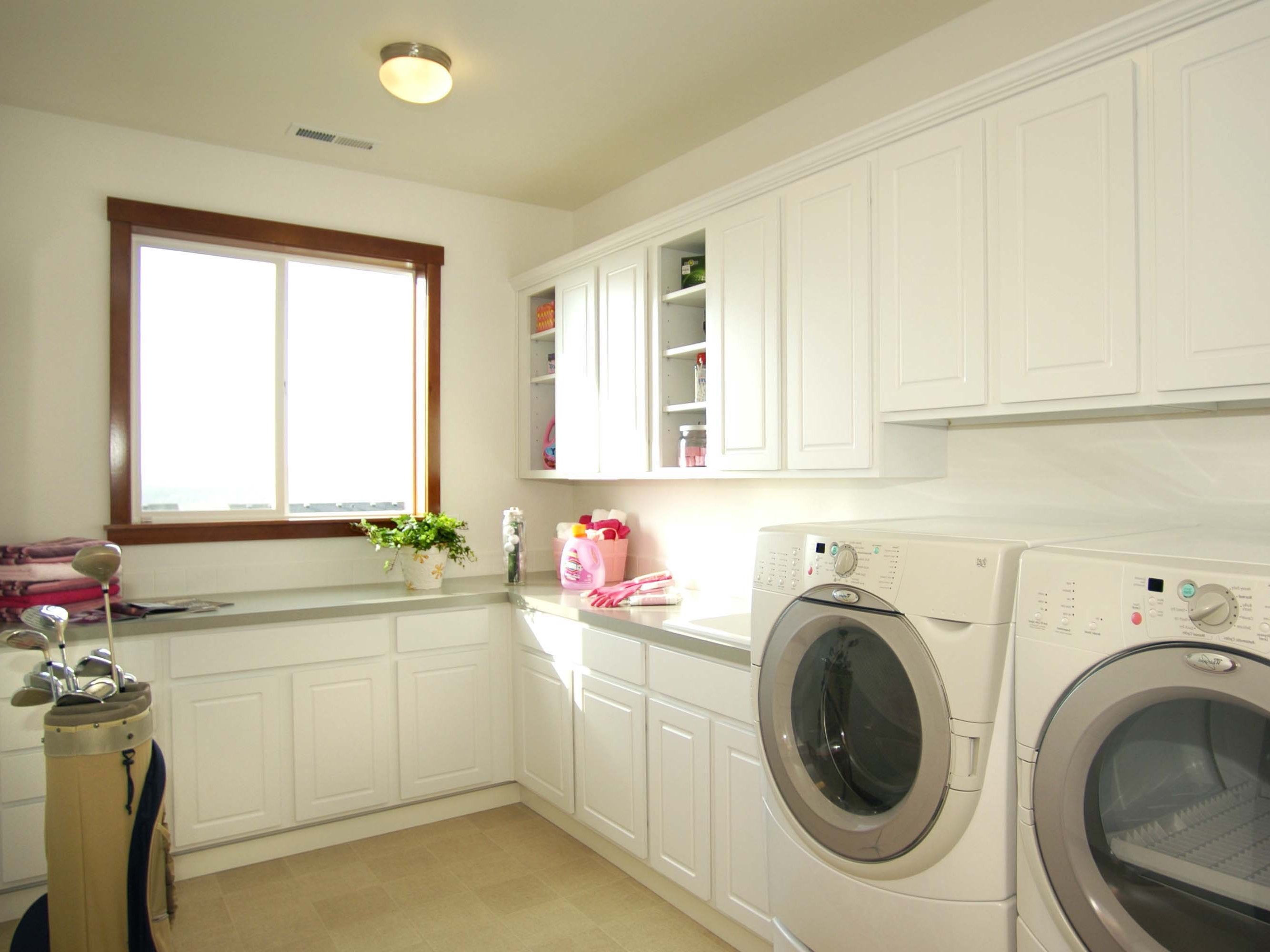 Fresh And Clean Laundry Room In Minimalist Design With Built In Storage Cabinets (Image 10 of 26)