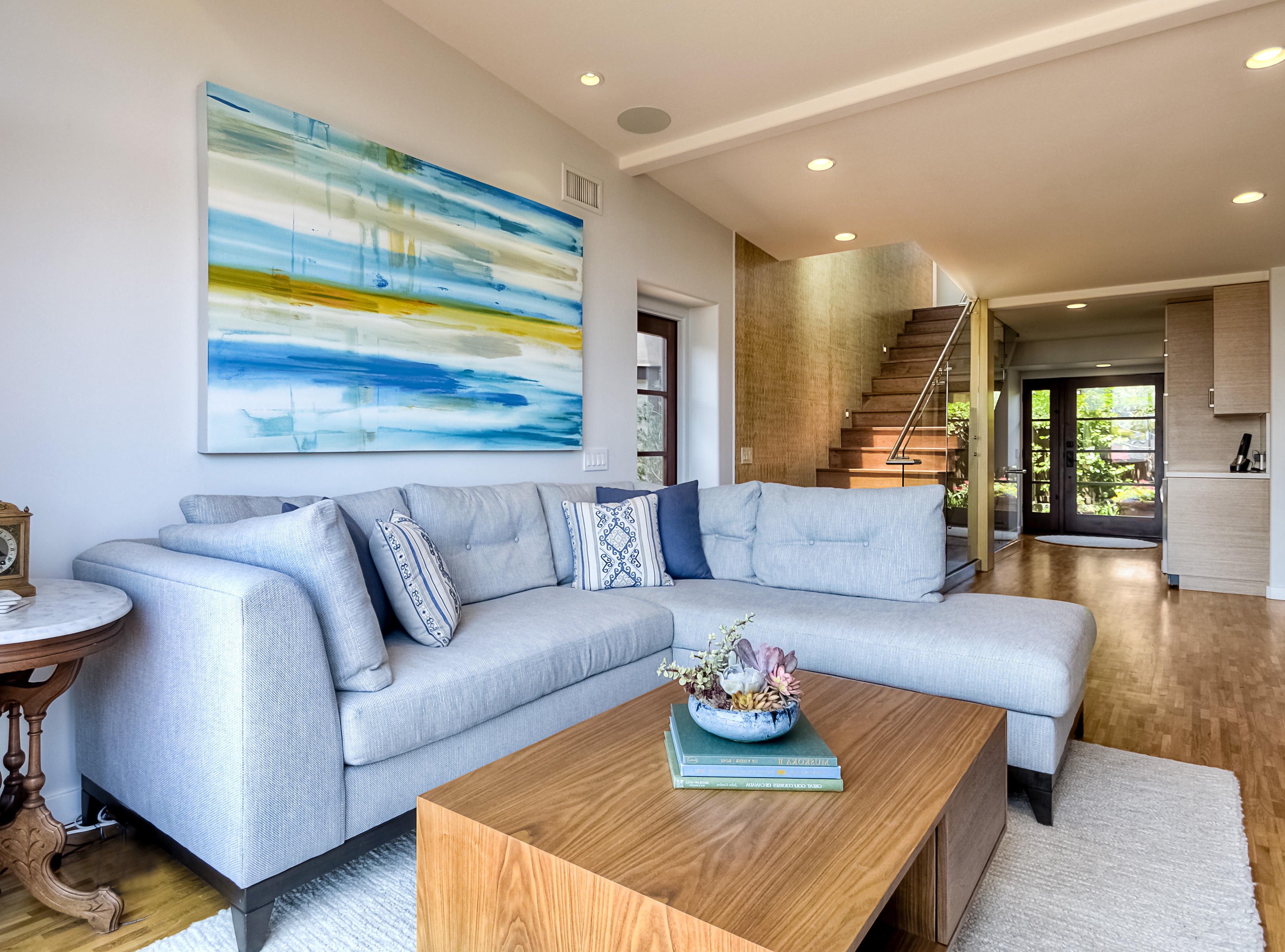 Ice Blue Sectional Sofa And Ocean Inspired Modern Art (Image 16 of 25)