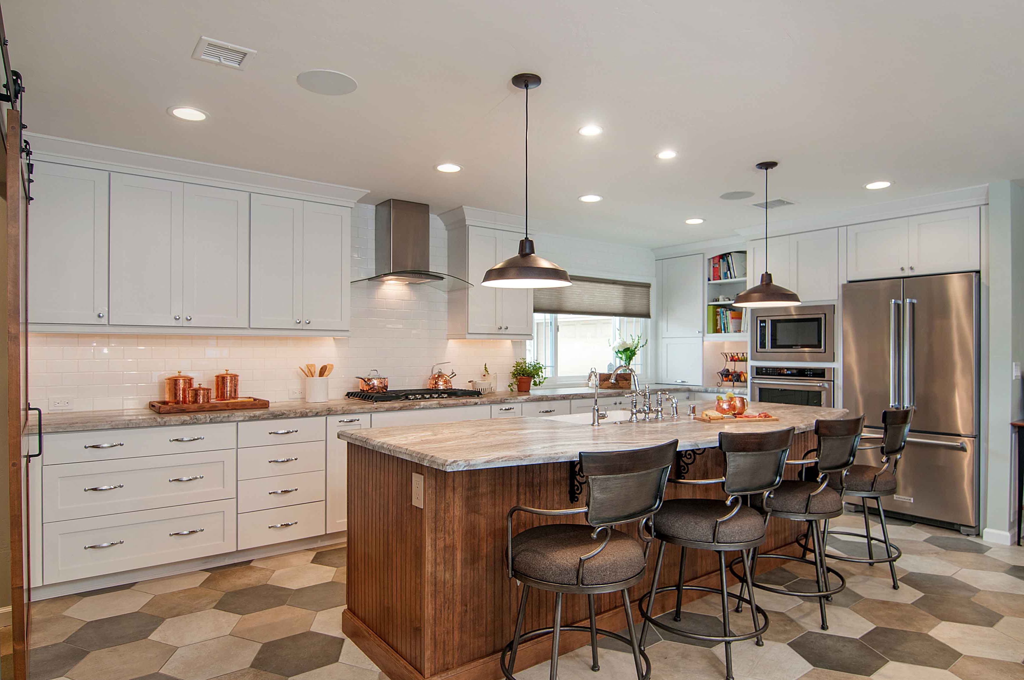Large Open Kitchen Island With Neutral Marble Countertop, Taupe Bar Chairs And Pendant Lights (Image 4 of 23)