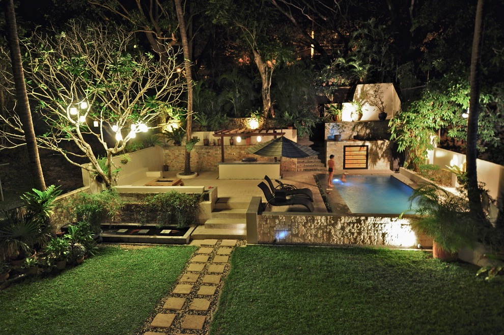 Large Tropical Garden Features Swimming Pool With Barbeque Area And Patio (Image 9 of 26)