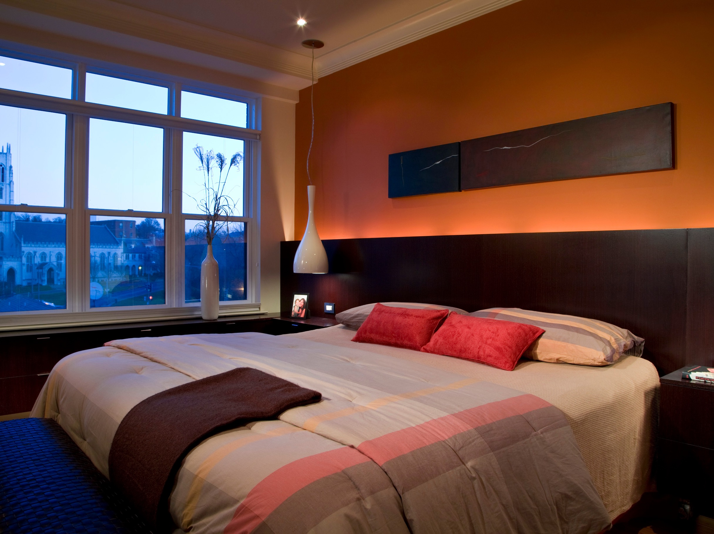 masculine orange bedroom color with dramatic lighting image 11 of 22