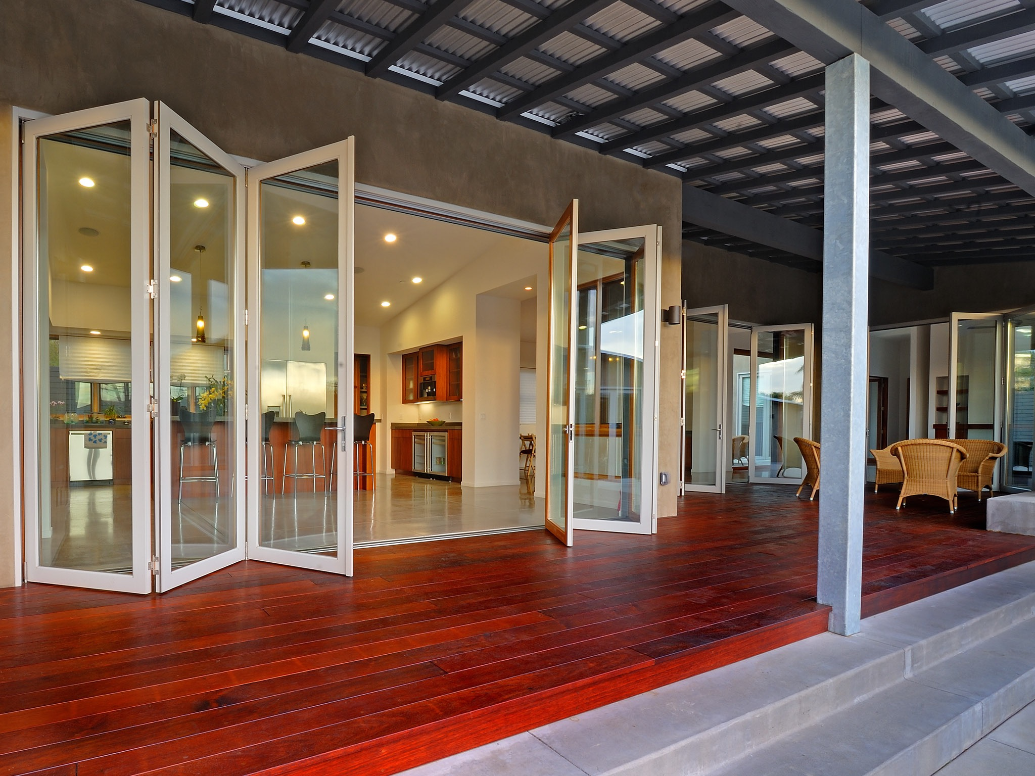 Modern Large Bifold Glass Doors Open To Deck (Image 17 of 24)