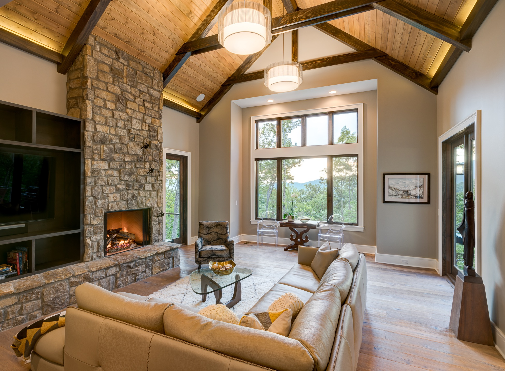 Neutral Rustic Living Room With Wood Ceiling And Stone Fireplace (Image 20 of 36)