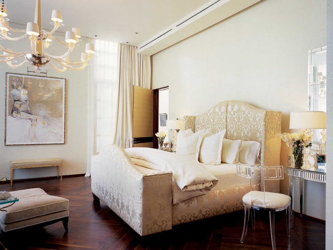Neutral Victorian Bedroom With Ornate Headboard And Chandelier (Image 7 of 19)