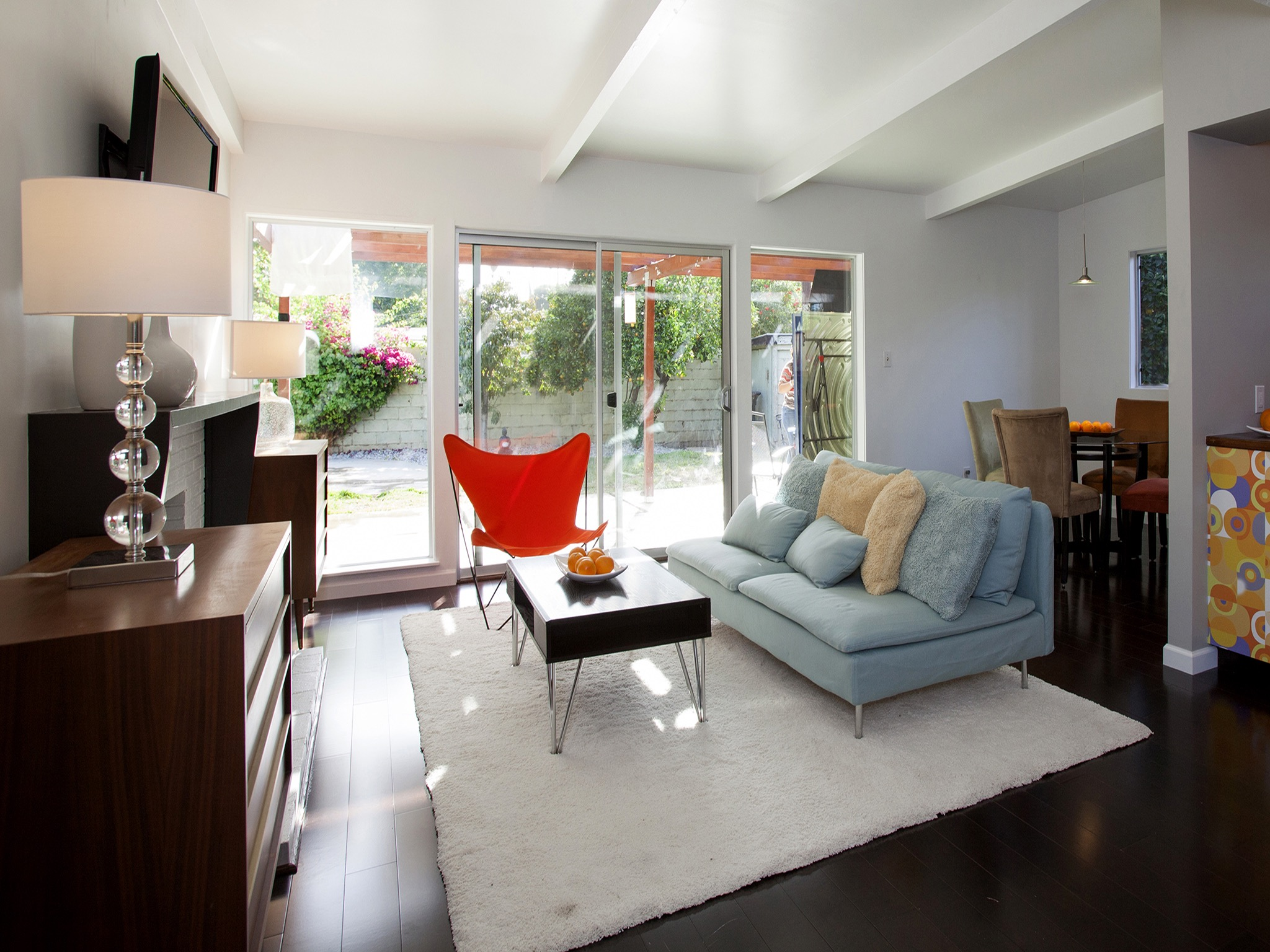Open Living Area With Contemporary Blue Sofa (Image 23 of 25)