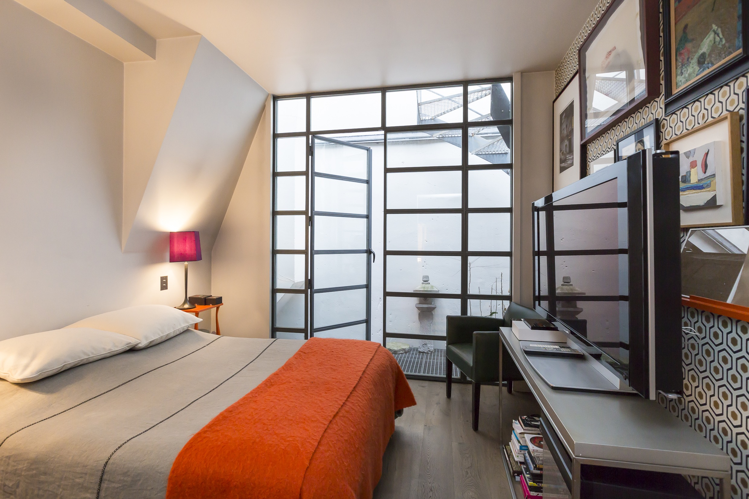 Parisian Loft Bedroom With Floor To Ceiling Glass Doors (Image 19 of 32)
