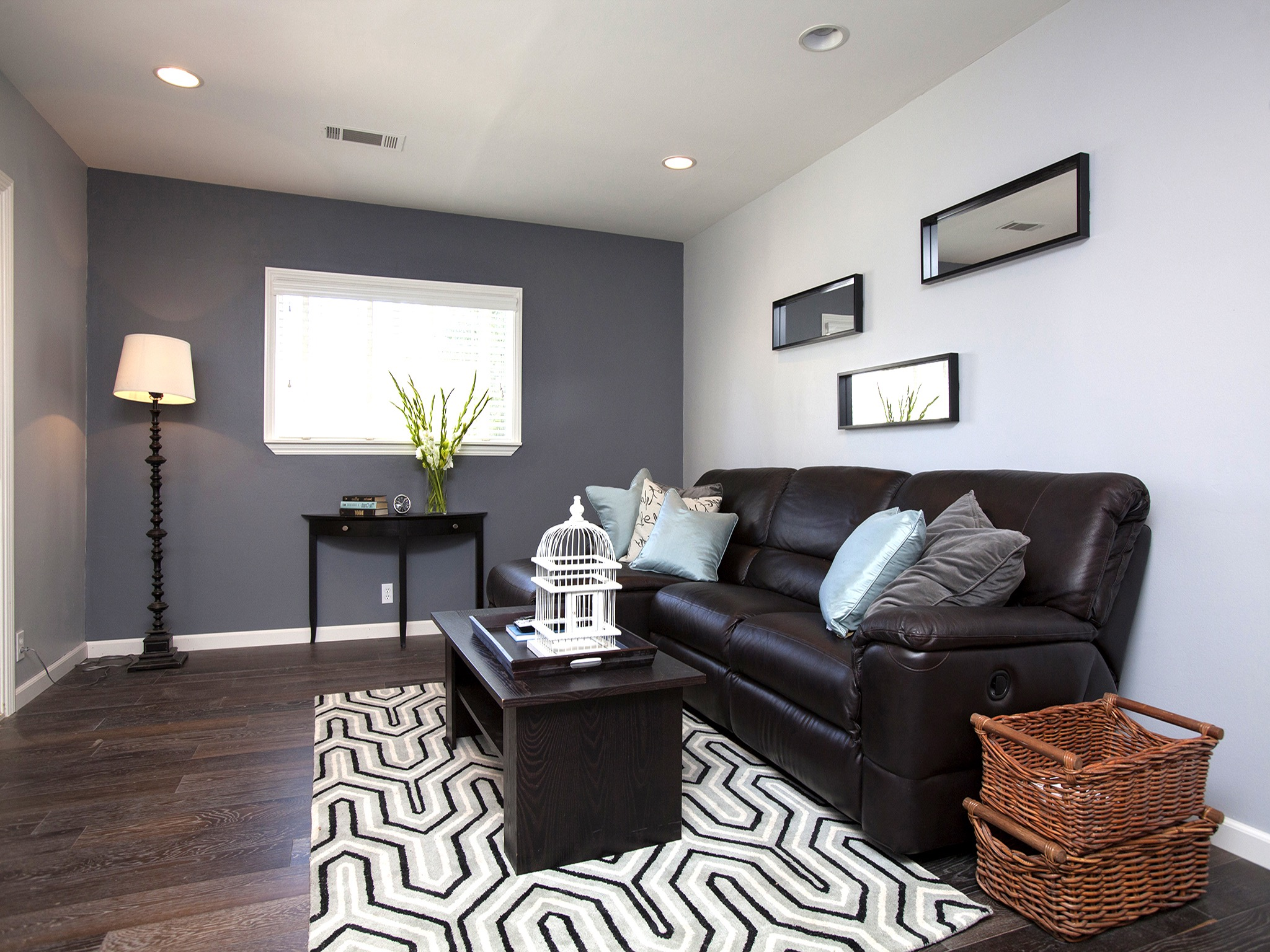 Simple Narrow Living Room With Black Sofa And Carpet (Image 15 of 22)