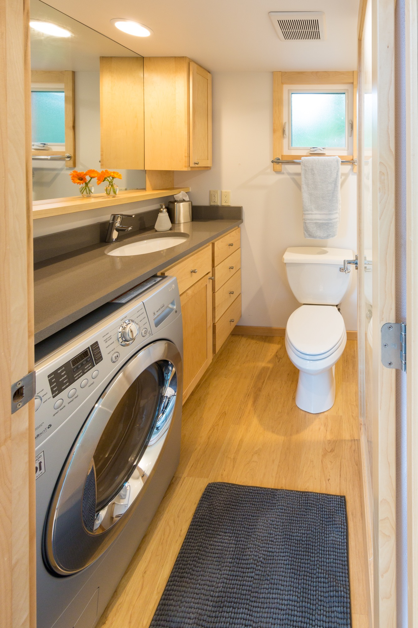 Small Bathroom And Laundry Combo Maximizes Square Footage (View 6 of 14)