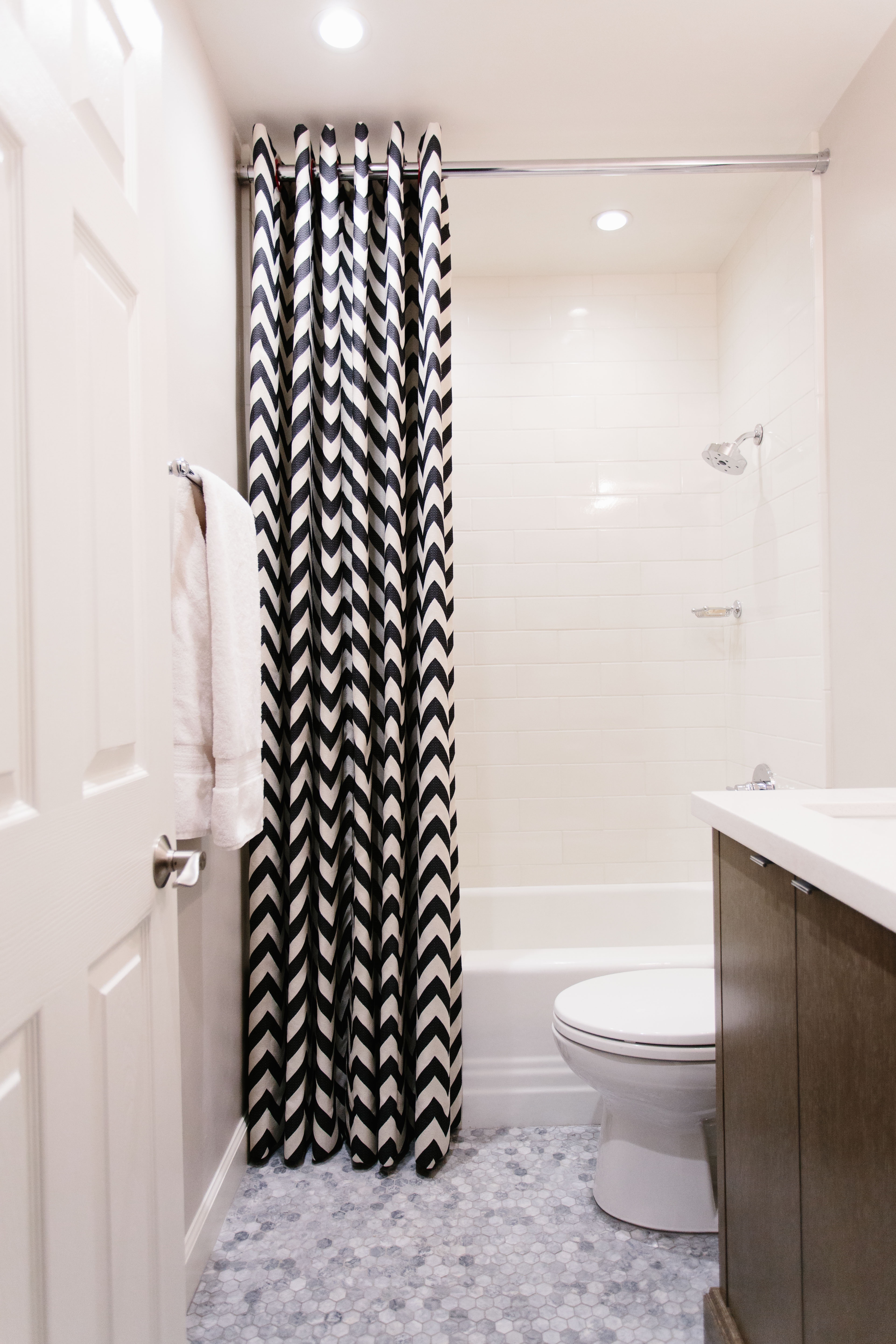 Small Bathroom In White With Black And White Shower Curtain (View 11 of 14)