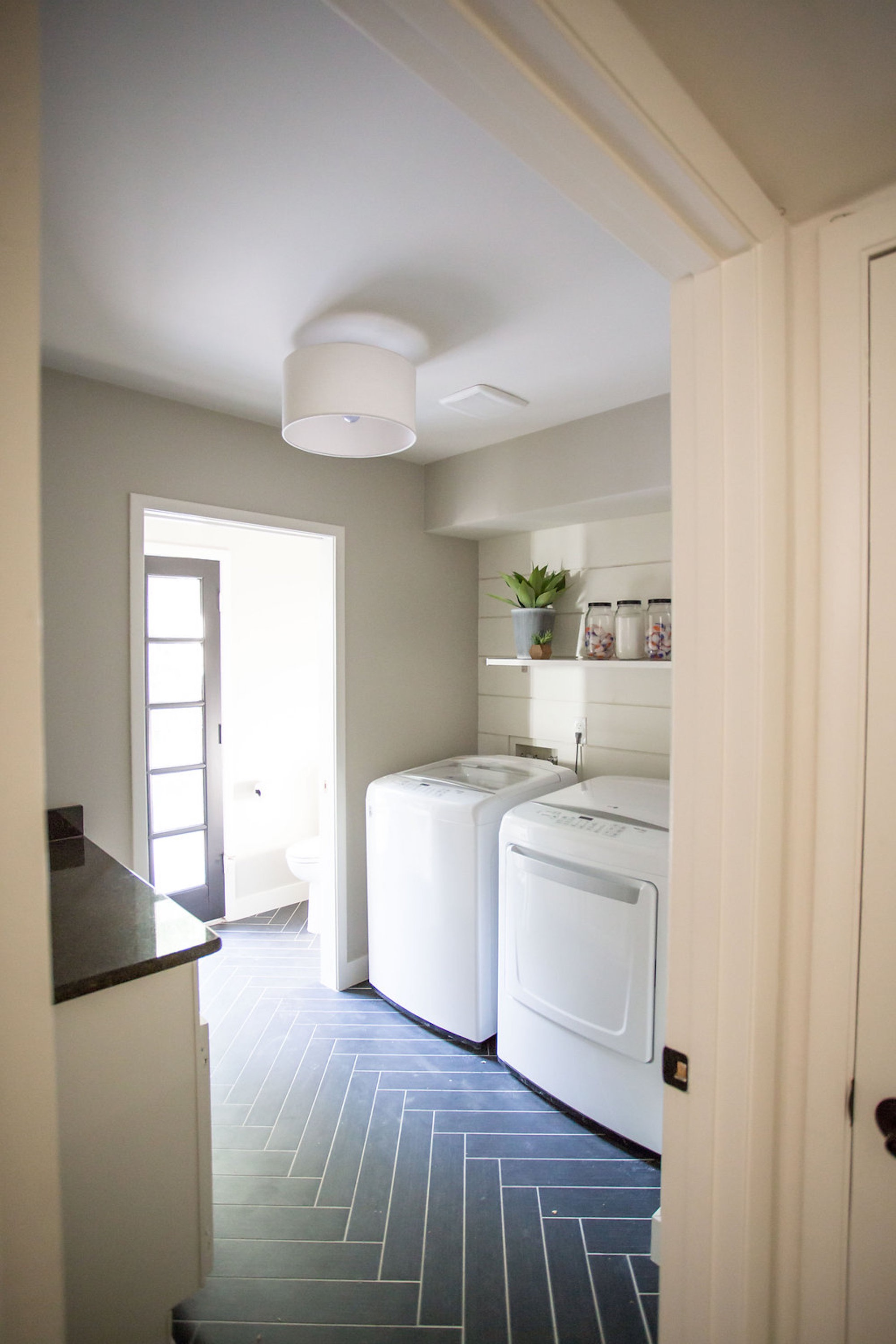 Spacious Laundry Room With Floating Shelf And Side By Side Machine Set Up (Image 19 of 26)