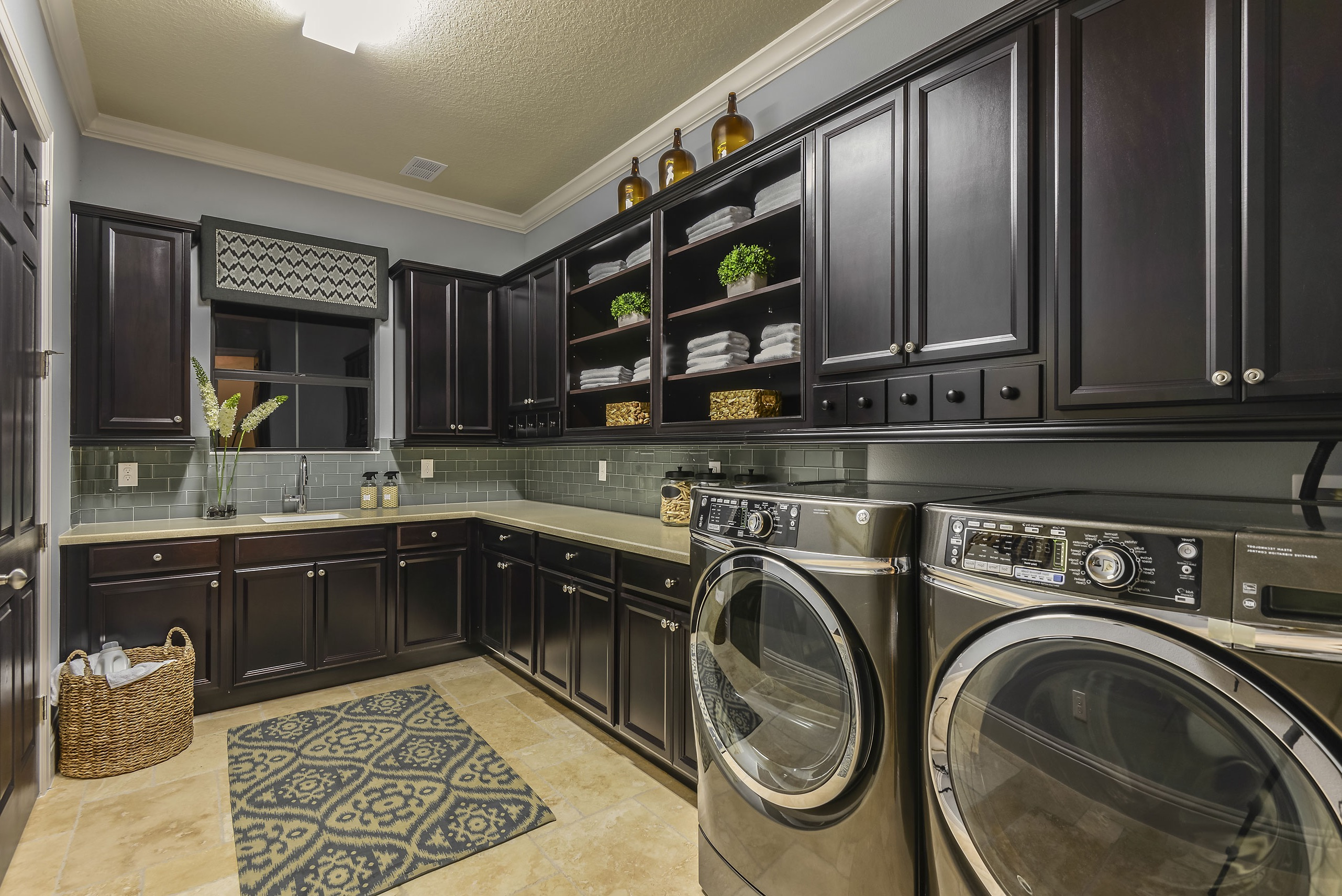 Spacious Modern Laundry Room With Black Storage Cabinets (Image 20 of 26)