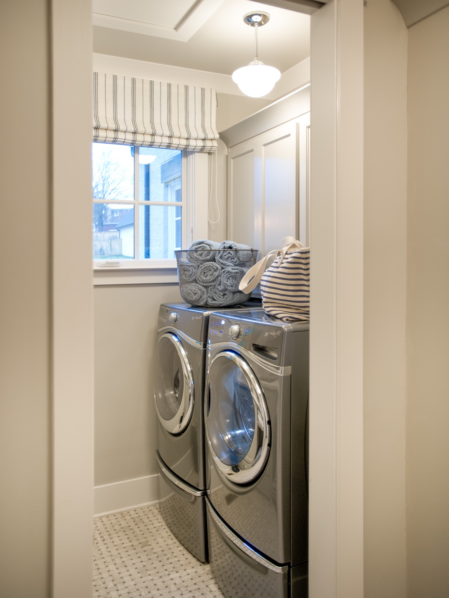 Traditional Laundry Room With Front Loading Appliances Washer And Dryer (Image 22 of 26)
