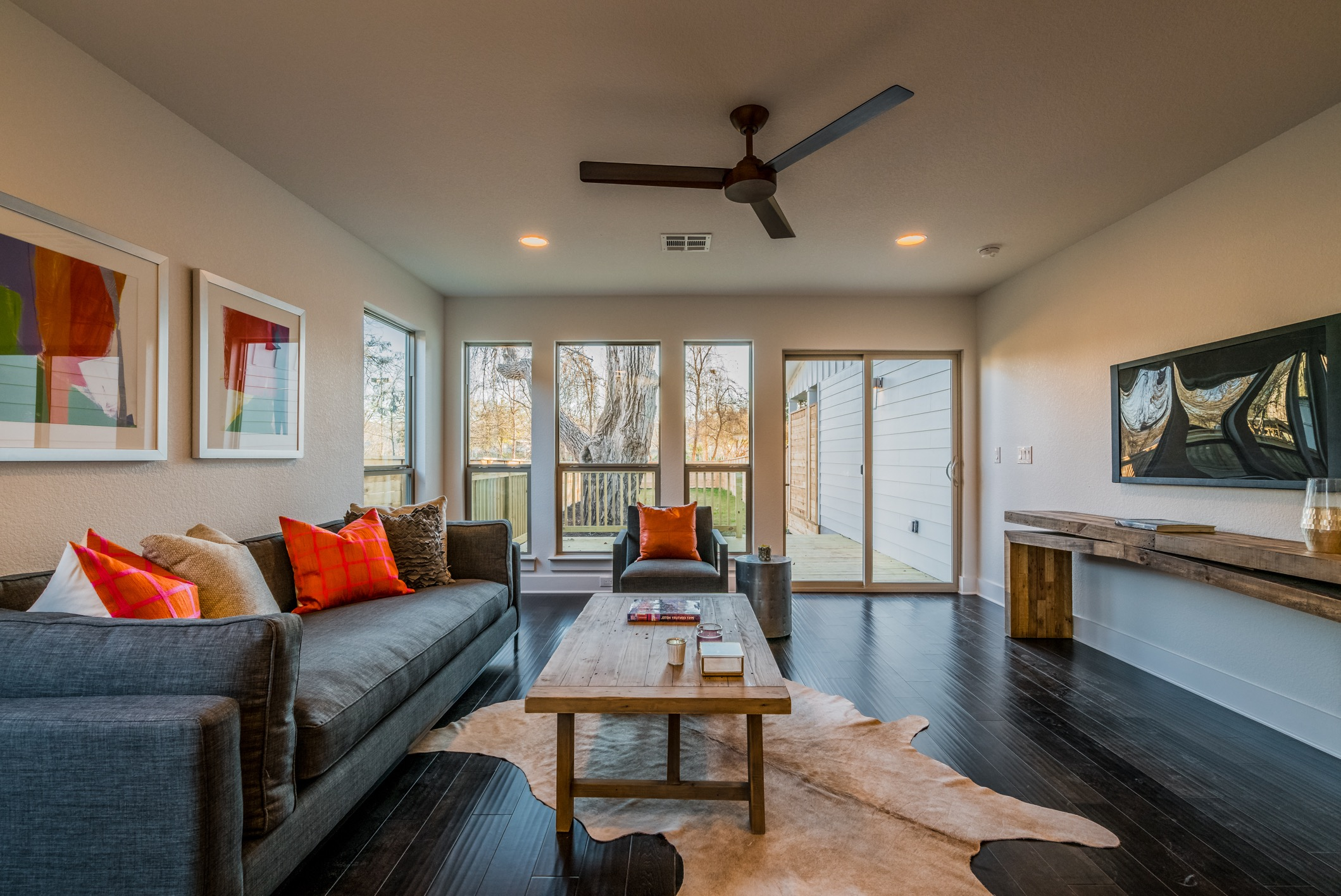 Windows And Sliding Glass Door Provide Backyard Access For Modern Living Room (View 12 of 13)