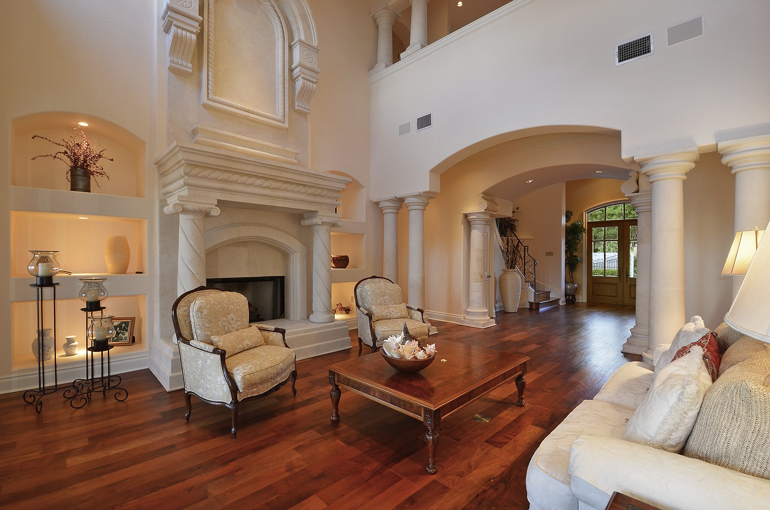 Classic Mediterranean Living Room With Wooden Flooring And White Sofa (Image 1 of 25)