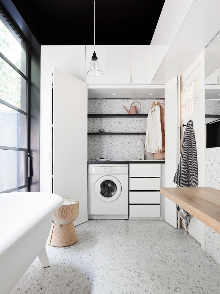 Compact And Functional Contemporary Laundry And Bathroom Interior Combo With Bi Fold Doors (Image 3 of 15)